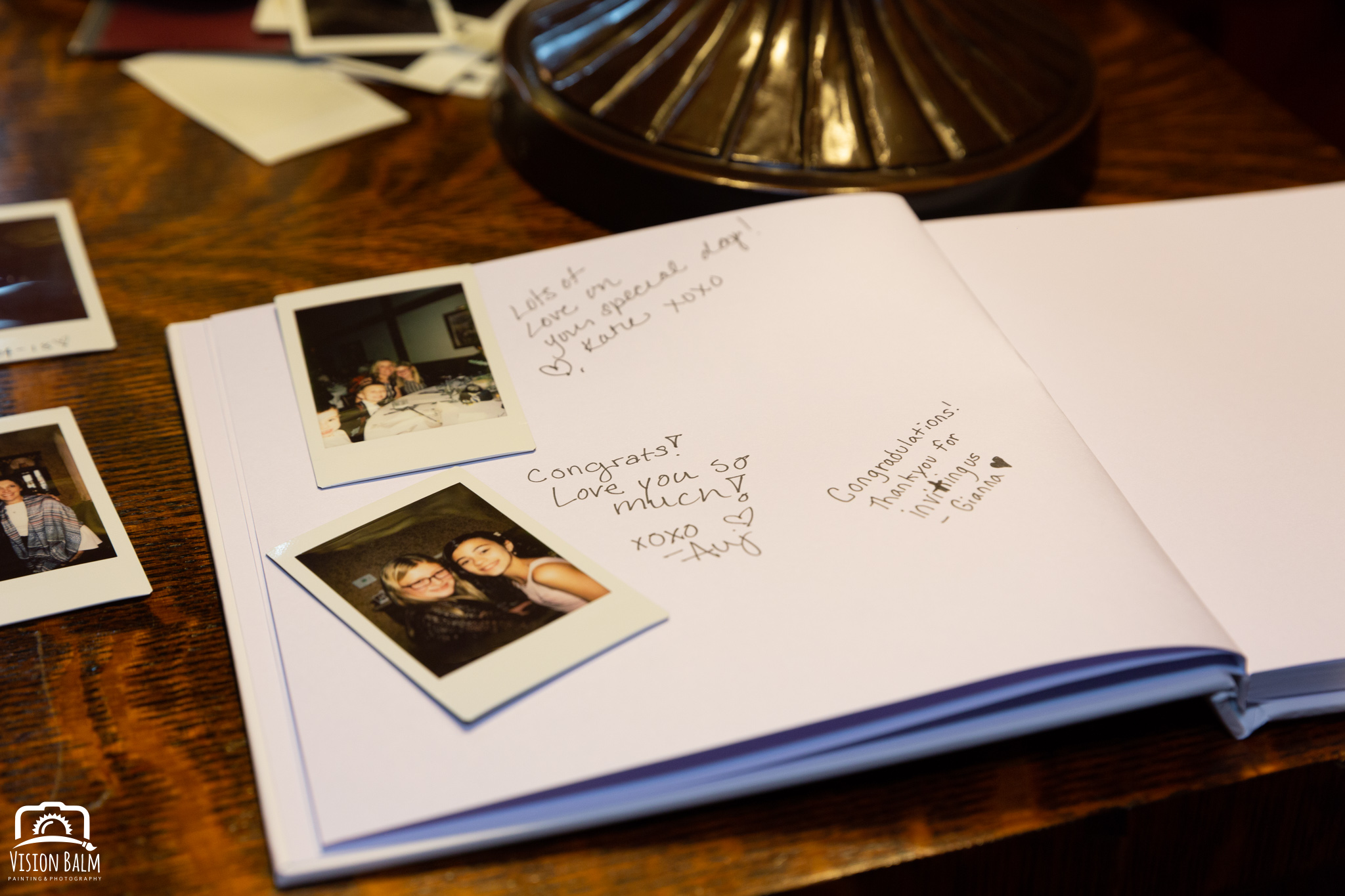 Wedding details photo of a book with photos in the venue of Zuka's Hilltop Barn by Vision Balm in Charleston, SC.