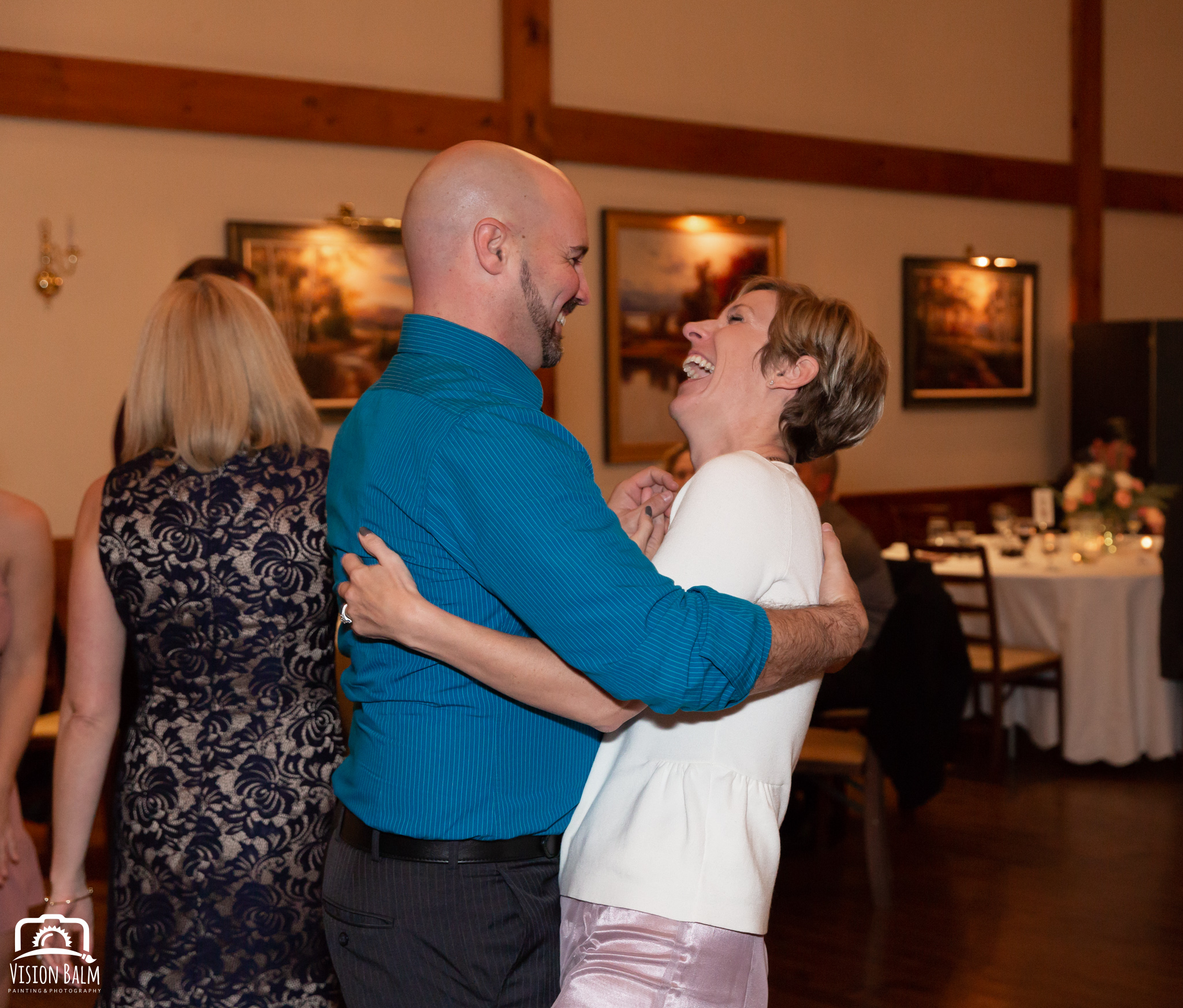 Wedding photo of wedding guests in the venue of Zuka's Hilltop Barn by Vision Balm in Charleston, SC.