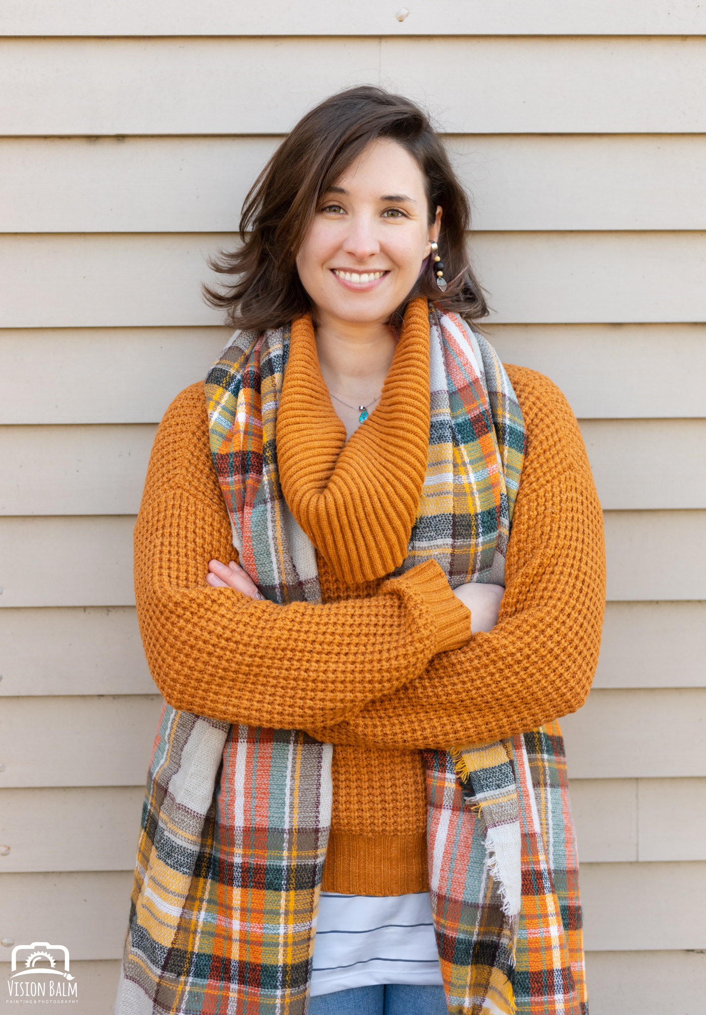 Professional fall portrait photography of Kayla Thornquist comic book artist and illustrator wearing an orange sweater photographed by Vision Balm in Charleston, SC.