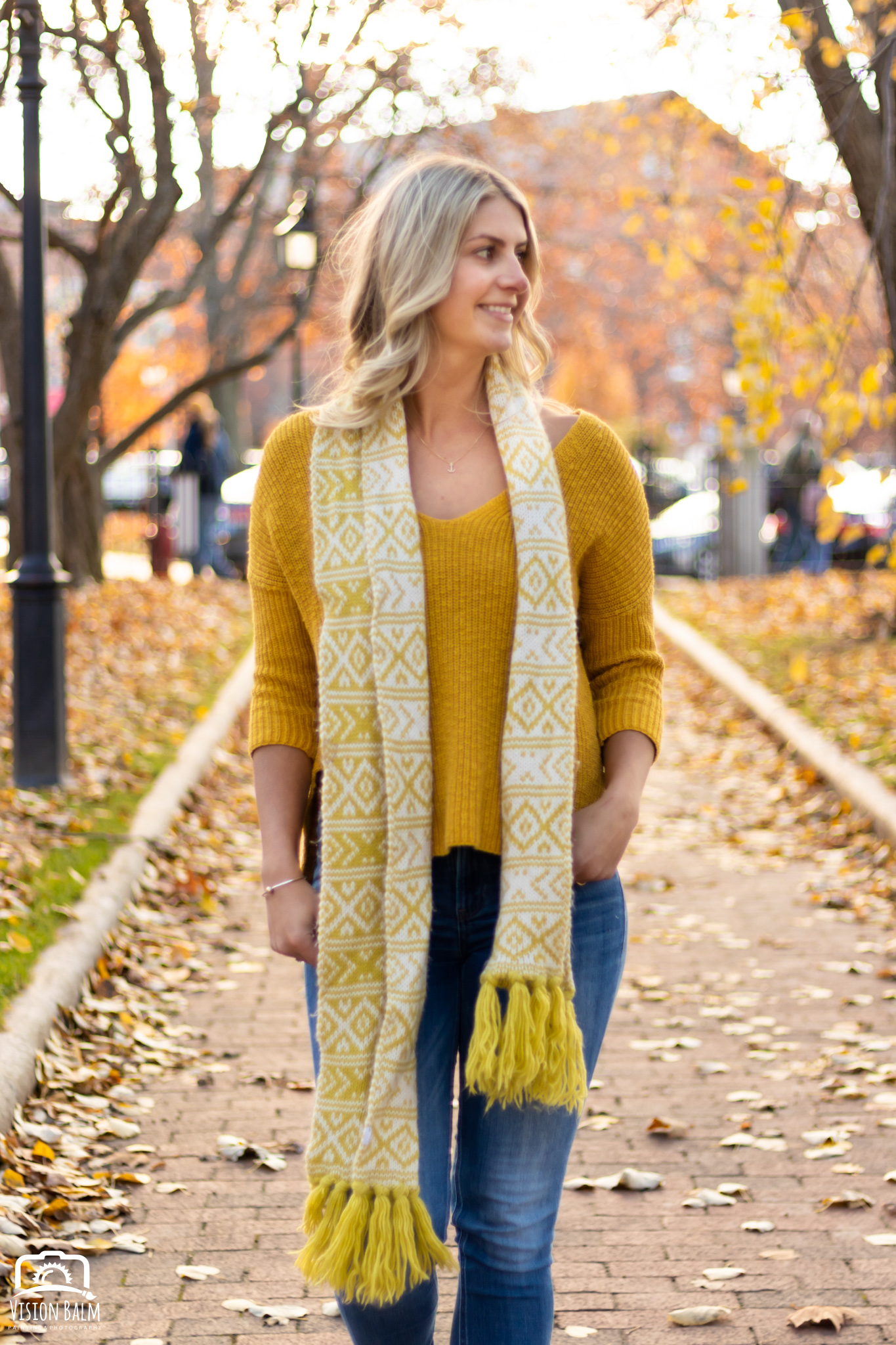 Professional fall portrait photography of model wearing a yellow sweater photographed by Vision Balm in Charleston, SC.