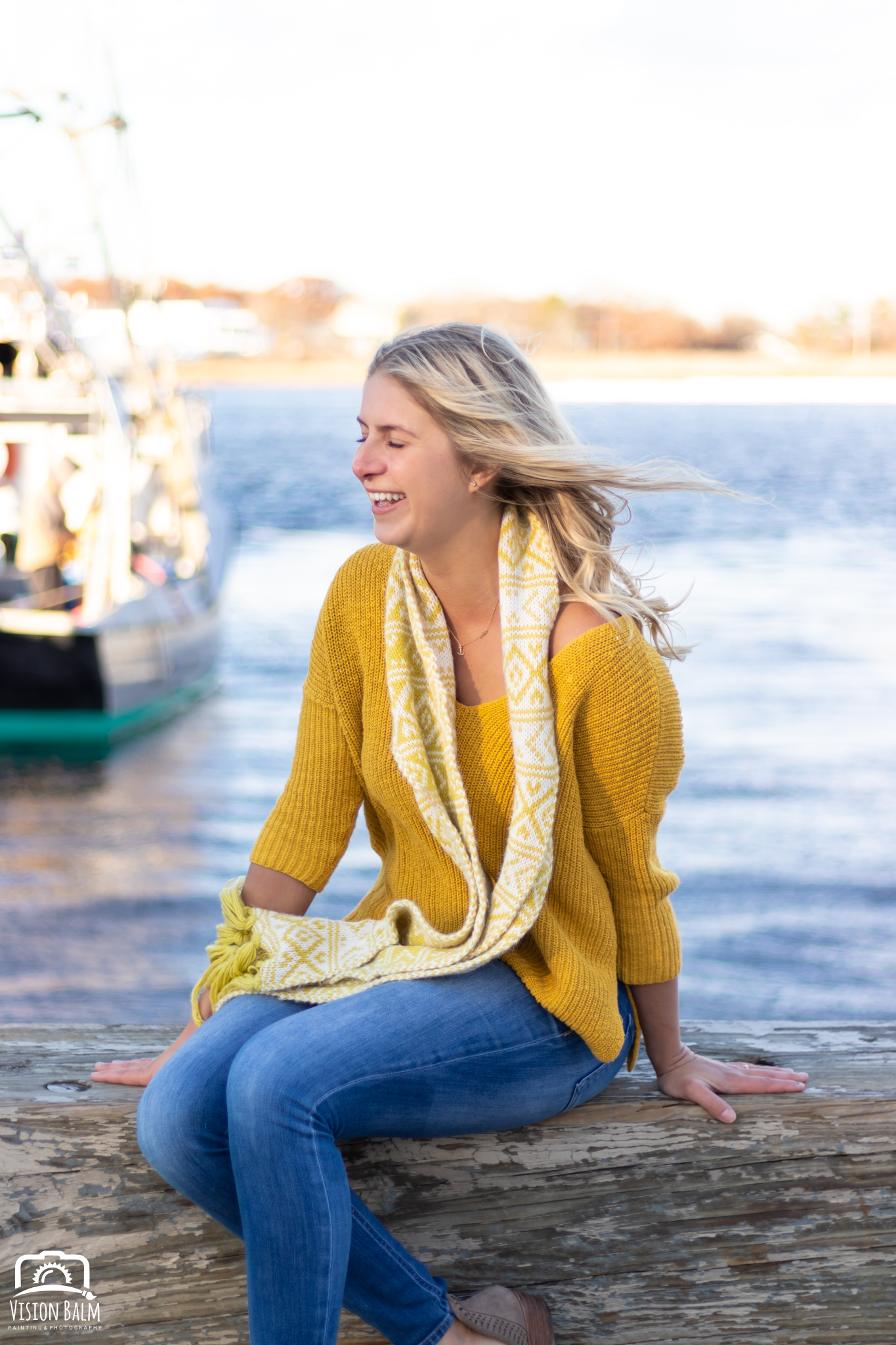 Professional fall portrait photography of model wearing a yellow sweater in downtown Newburyport, MA photographed by Vision Balm in Charleston, SC.