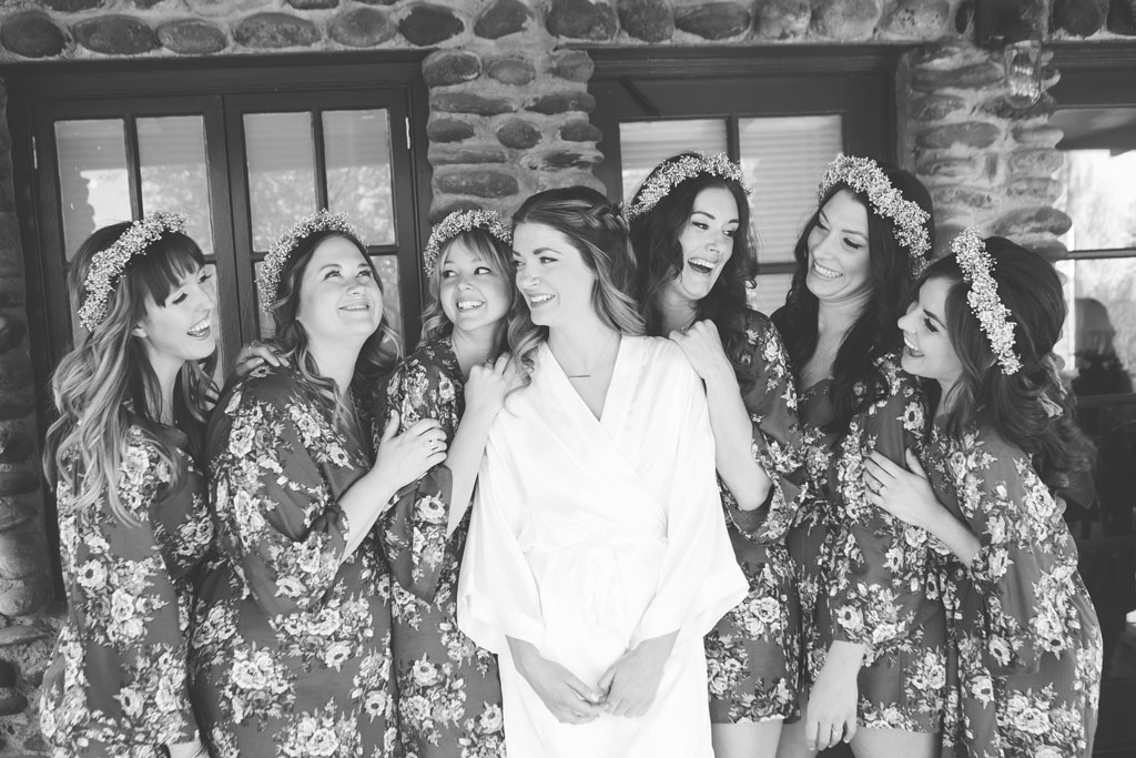 bohemian bridesmaids in floral robes and flower crowns