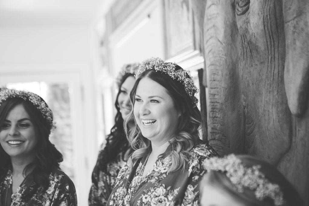 bridesmaids getting ready in flower crowns