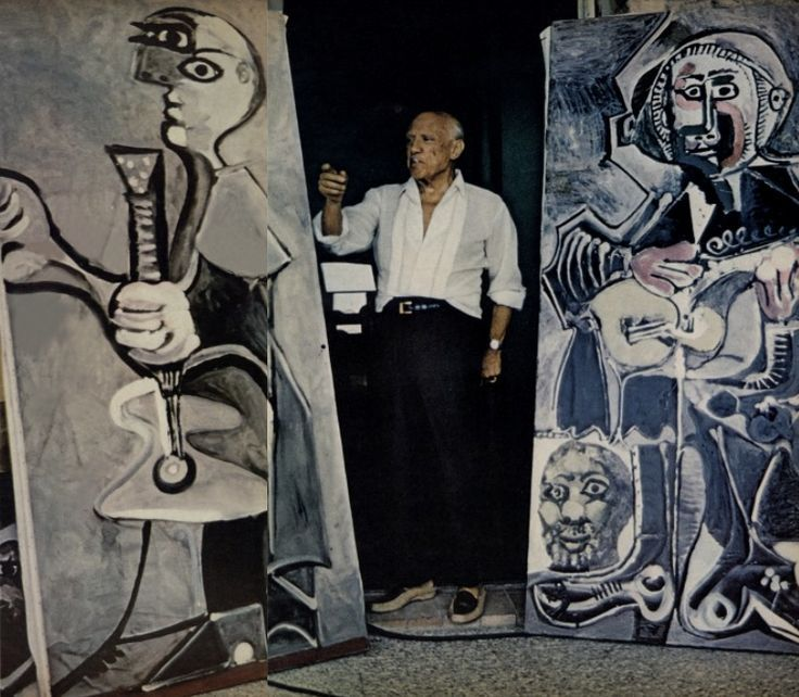 Picasso with two of his works.