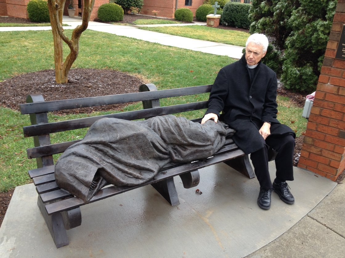 """gallifreekydeeky :       nitro-nova-deactivated20180206 :     A new religious statue in the town of Davidson, N.C., is unlike anything you might see in church.   The statue depicts Jesus as a vagrant sleeping on a park bench. St. Alban's Episcopal Church installed the homeless Jesus statue on its property in the middle of an upscale neighborhood filled with well-kept townhomes.   Jesus is huddled under a blanket with his face and hands obscured; only the crucifixion wounds on his uncovered feet give him away.   The reaction was immediate. Some loved it; some didn't.   """"One woman from the neighborhood actually called police the first time she drove by,"""" says David Boraks, editor of DavidsonNews.net. """"She thought it was an actual homeless person.""""   That's right.  Somebody called the cops on Jesus.      """"ooh! a poor person in need of help! i better make sure they get arrested!"""" to me, that's the issue that's most troubling. Apart from that, the statue, and the idea behind it, is one of the parts of Christianity that even a grouchy atheist like me has to admire…"""