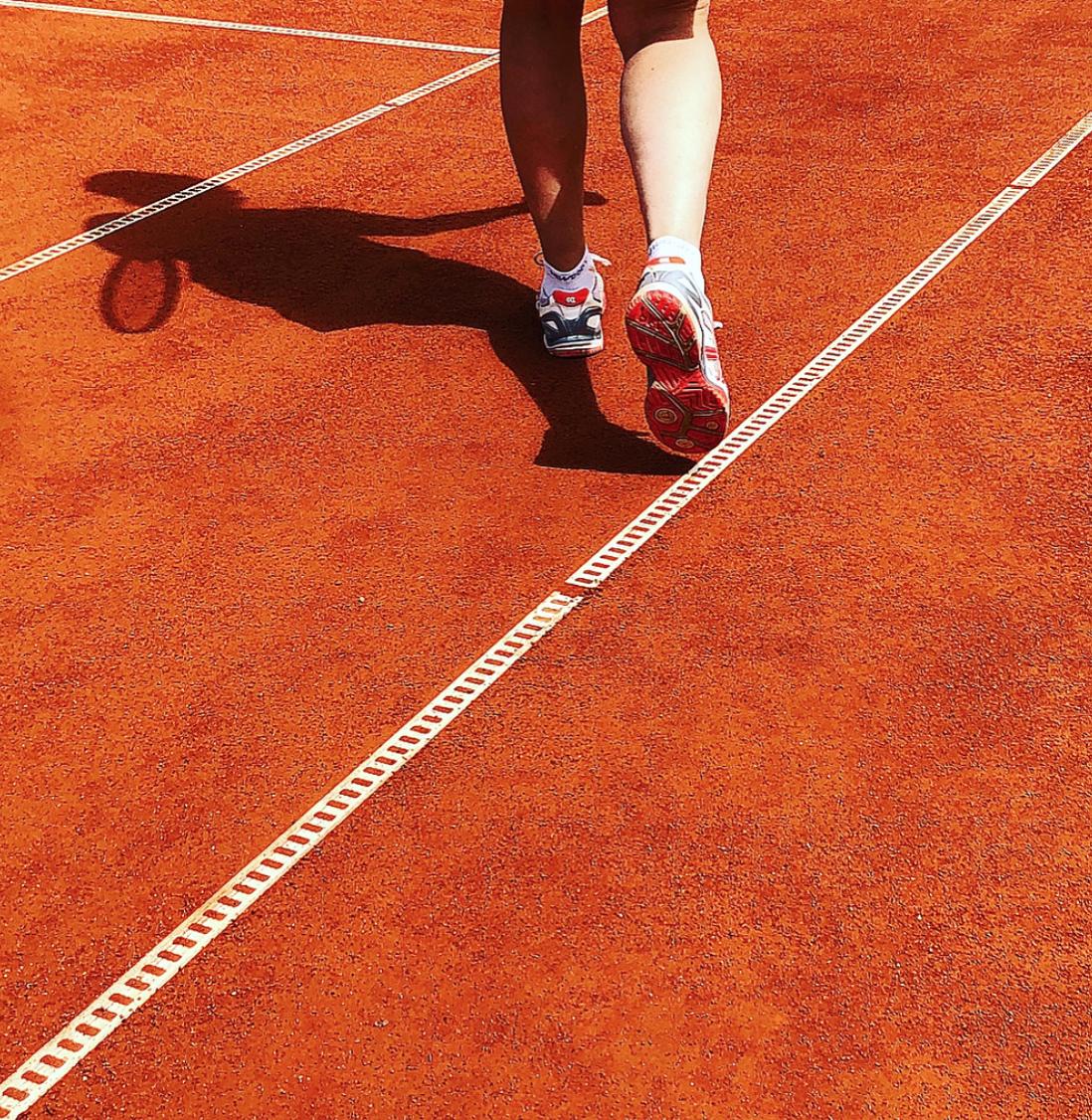 På tennisbanan