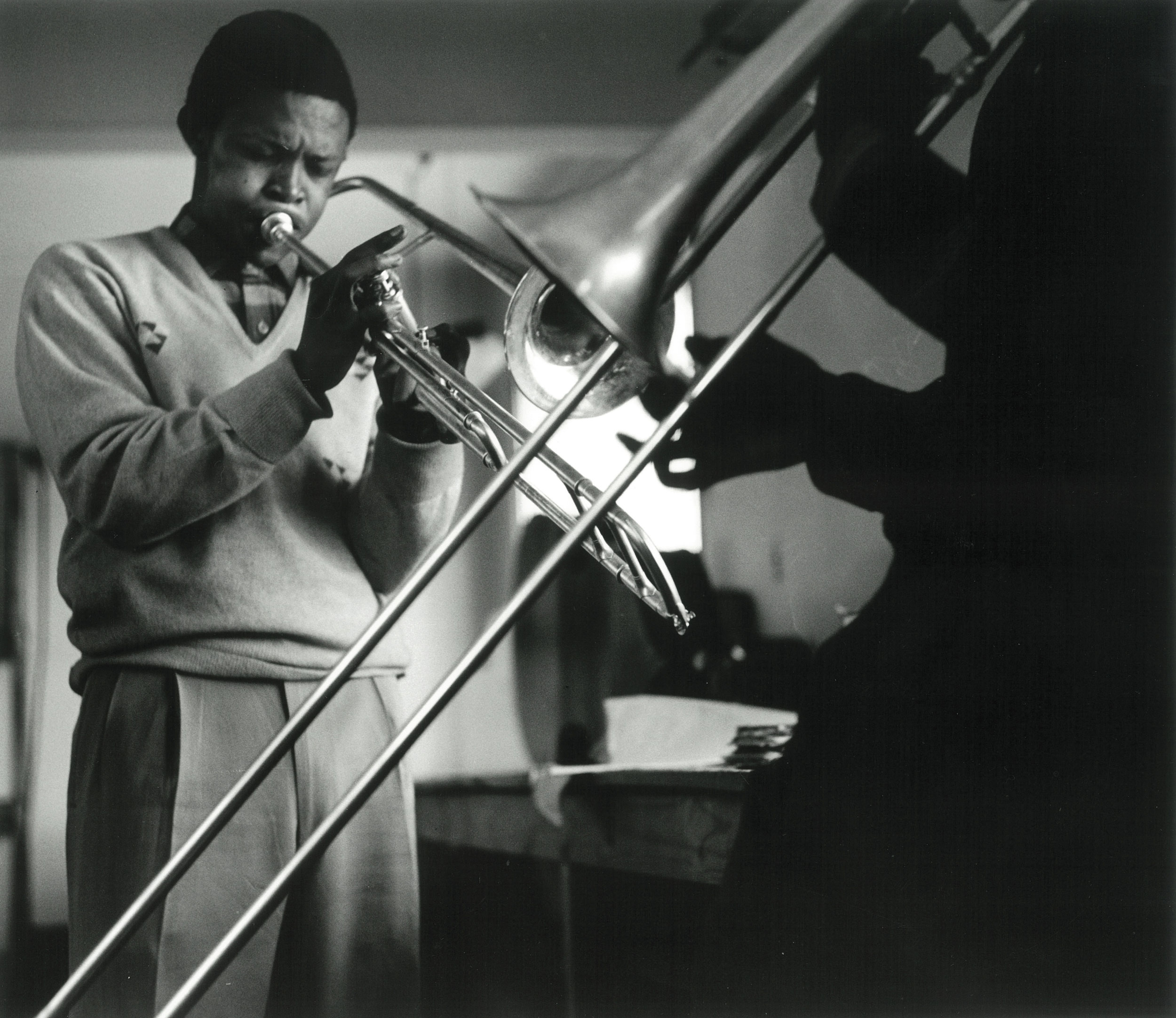 1956 – Hugh Masakela and Jonas Gwangwa practice at the Bantu Men's Social Club, Johannesburg   Courtesy of the Estate of John Goldblatt