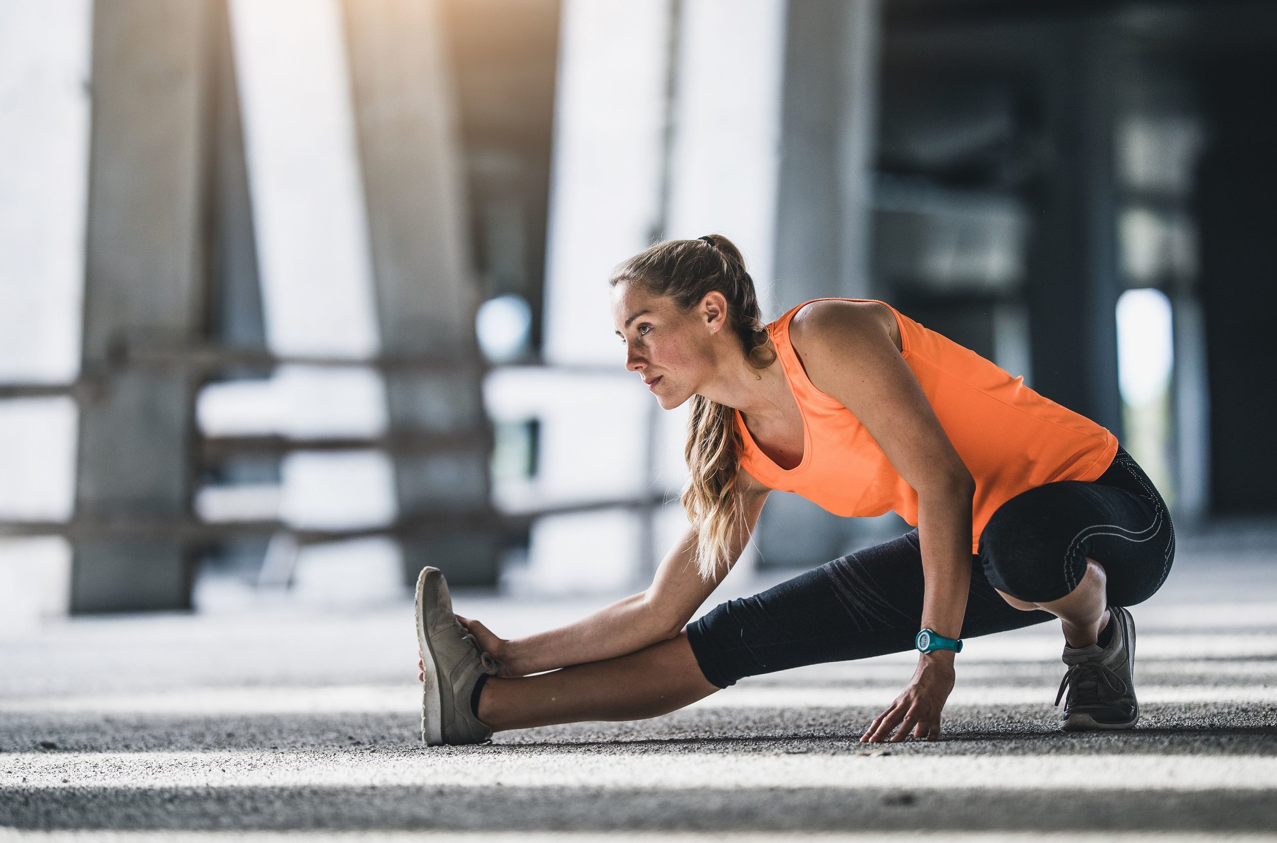 female-athlete-stretching-outdoors-royalty-free-image-810679678-1534524159.jpg