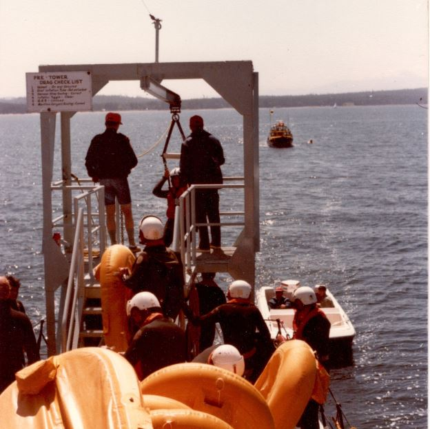 after ejecting and landing in the water, there is a serious risk of drowning because the pilot can be dragged upside down by the chute blown by the wind or else can get stuck under the wet parachute itself. This structure at the back of the boat dropped the student in to the water while the boat was moving at a relatively high speed. to survive, the students had to roll on to their back, splay their feet to stay above water and release themselves from the harness.