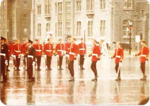 RMC Grad Parade March On in Rain.png