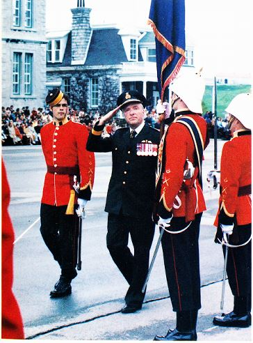CWC LAWSOn, ADM Falls, and colour party commanded by cadet wing officer terry wood