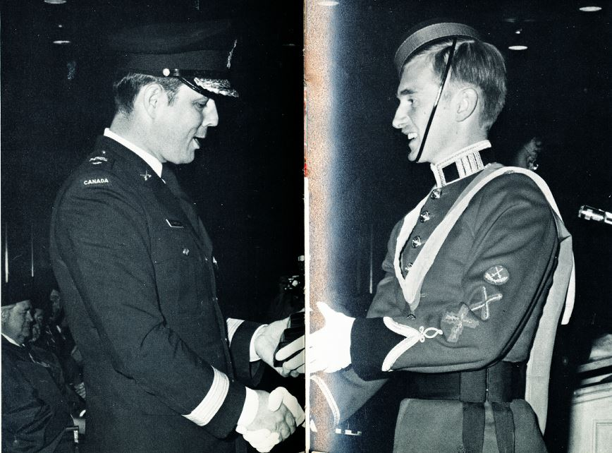 the cmdt, bgen de chastelain presenting CWO dwight davies with three academic medals - the governor general's gold medal for the highest academic standing in the class; the association of professional engineers medal for highest academic standing in engineering; and the departmental medal for highest academic standing in electrical engineering