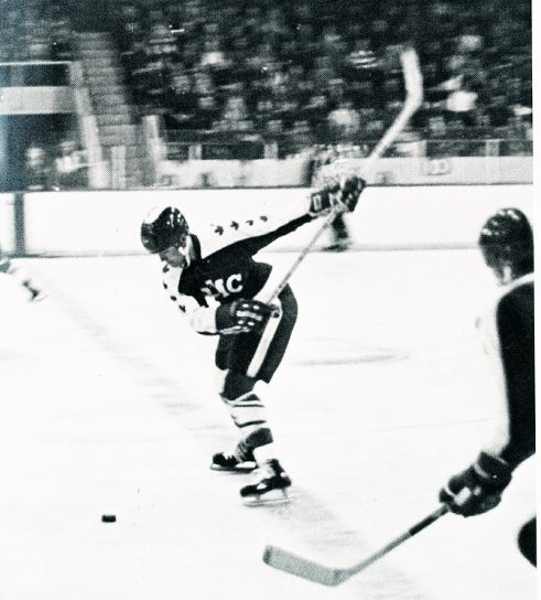Taking a slapshot at the memorial center during west point game in 1976, a game that ended in a 4-4 tie