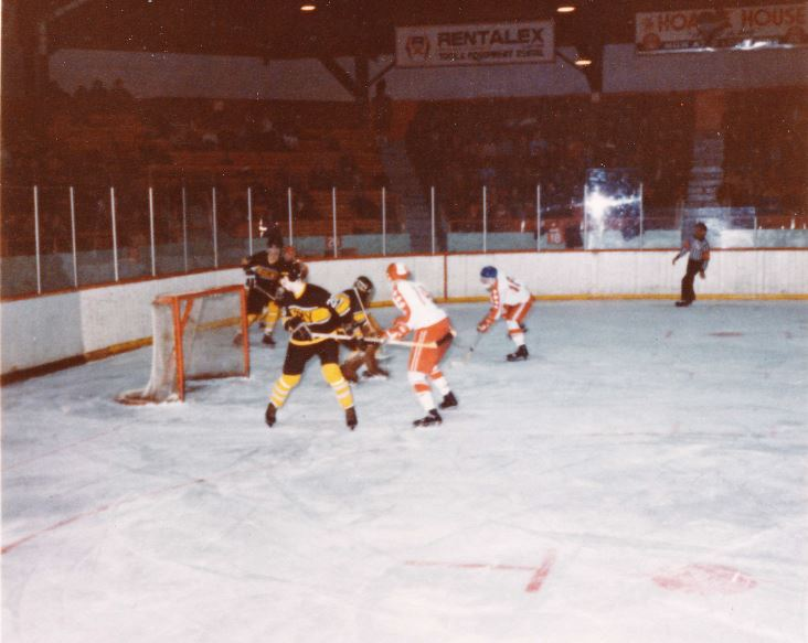 Al macleod (Blue experimental facemask) and farley in front of the west point net during 1978 game that was won by rmc 7-6