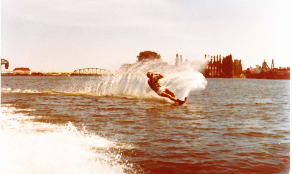 pete water-skiing, with the causeway lift bridge in the bacground
