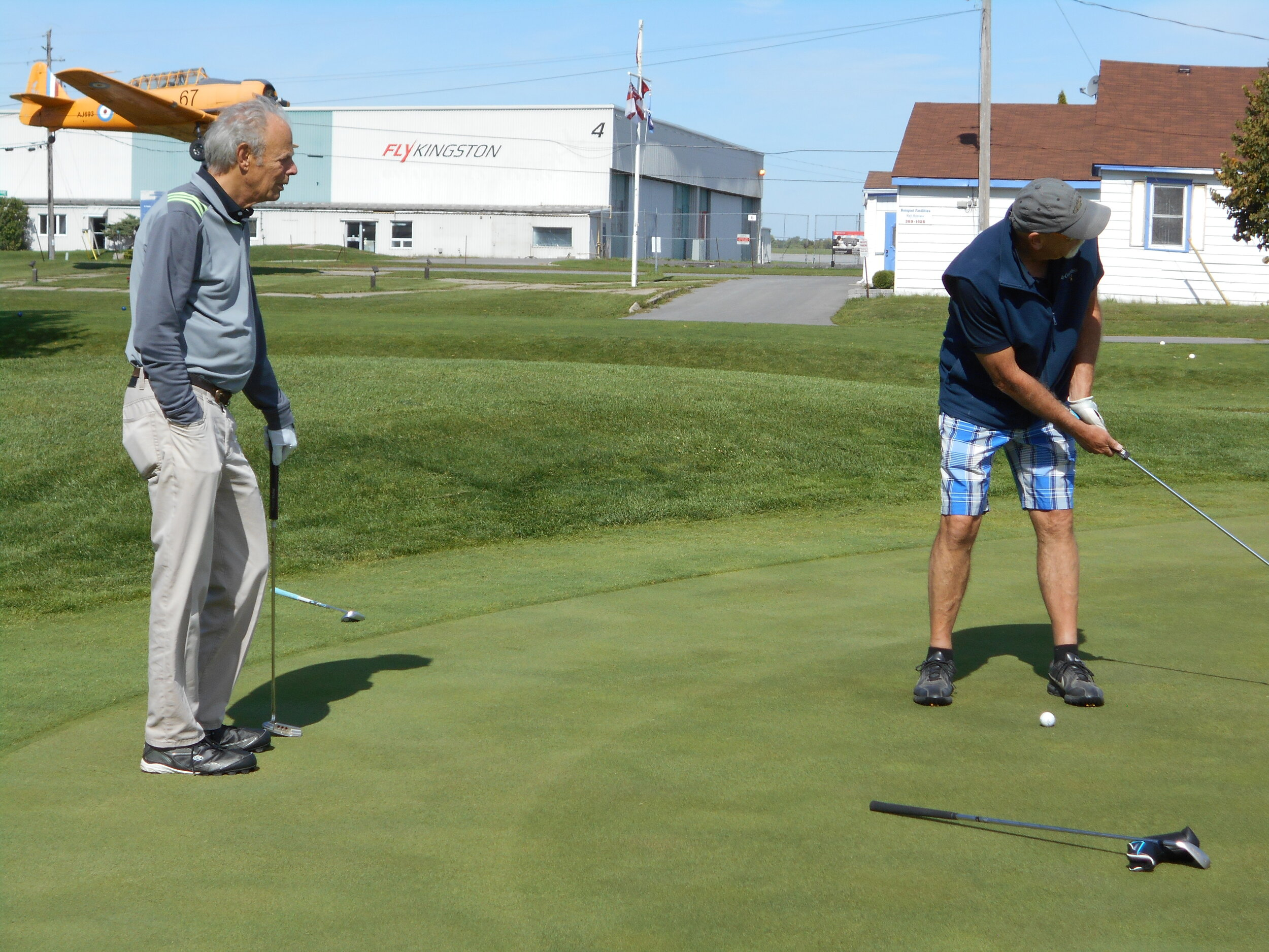 john britten - not sure were the putt went but he gets style points for the shorts