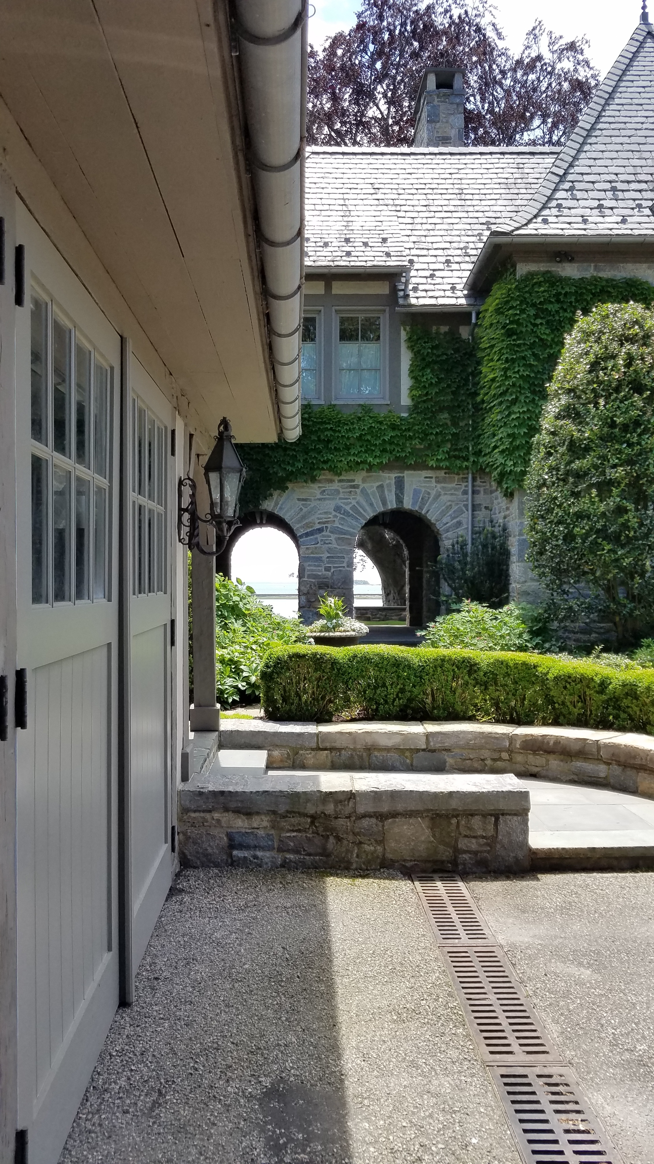 The beautiful view greets you as you arrive. That is the Long Island Sound seen through the arched breezeway.