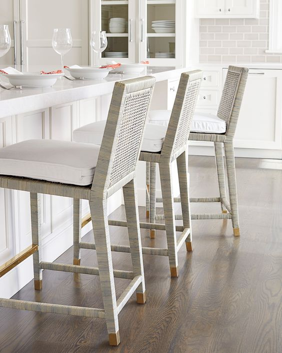 Elegant and Durable  : White washed rattan, white leather seating pad and brass footrest for durability.