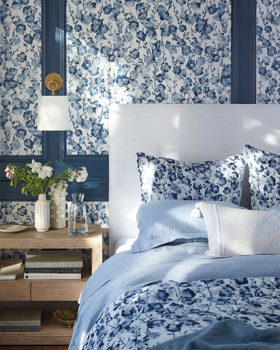 Beautiful bedroom with blue lacquer trim.  Serena and Lily wallpaper.
