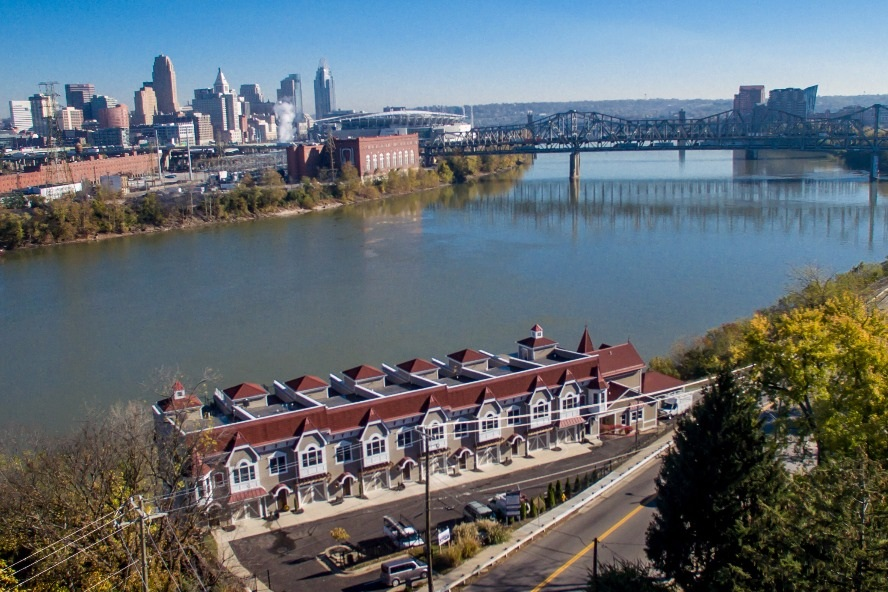 SOLD - Westport Townhomes   Covington, KY (Cincinnati MSA)  Westport Townhomes in the Covington KY MSA was a new development project acquired out of bank foreclosure. The project was completed and all units were sold within 36 months of acquisition.