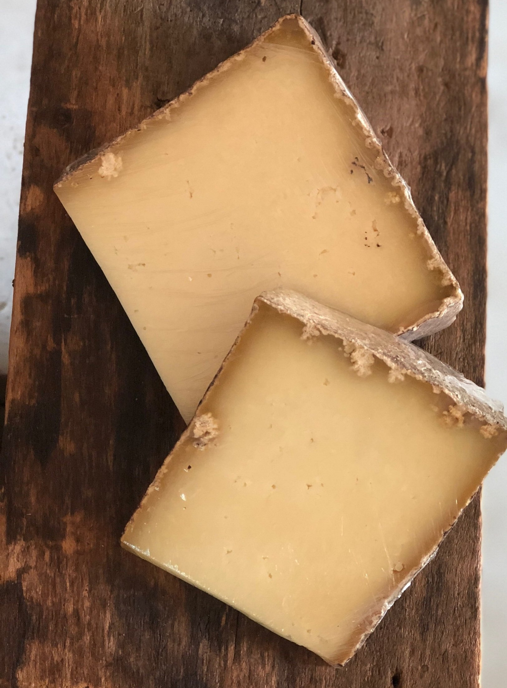 Grey Ghost , a French alpine style raw milk cheese, aged for 3-6 months in our cheese cave  Limited availability year round