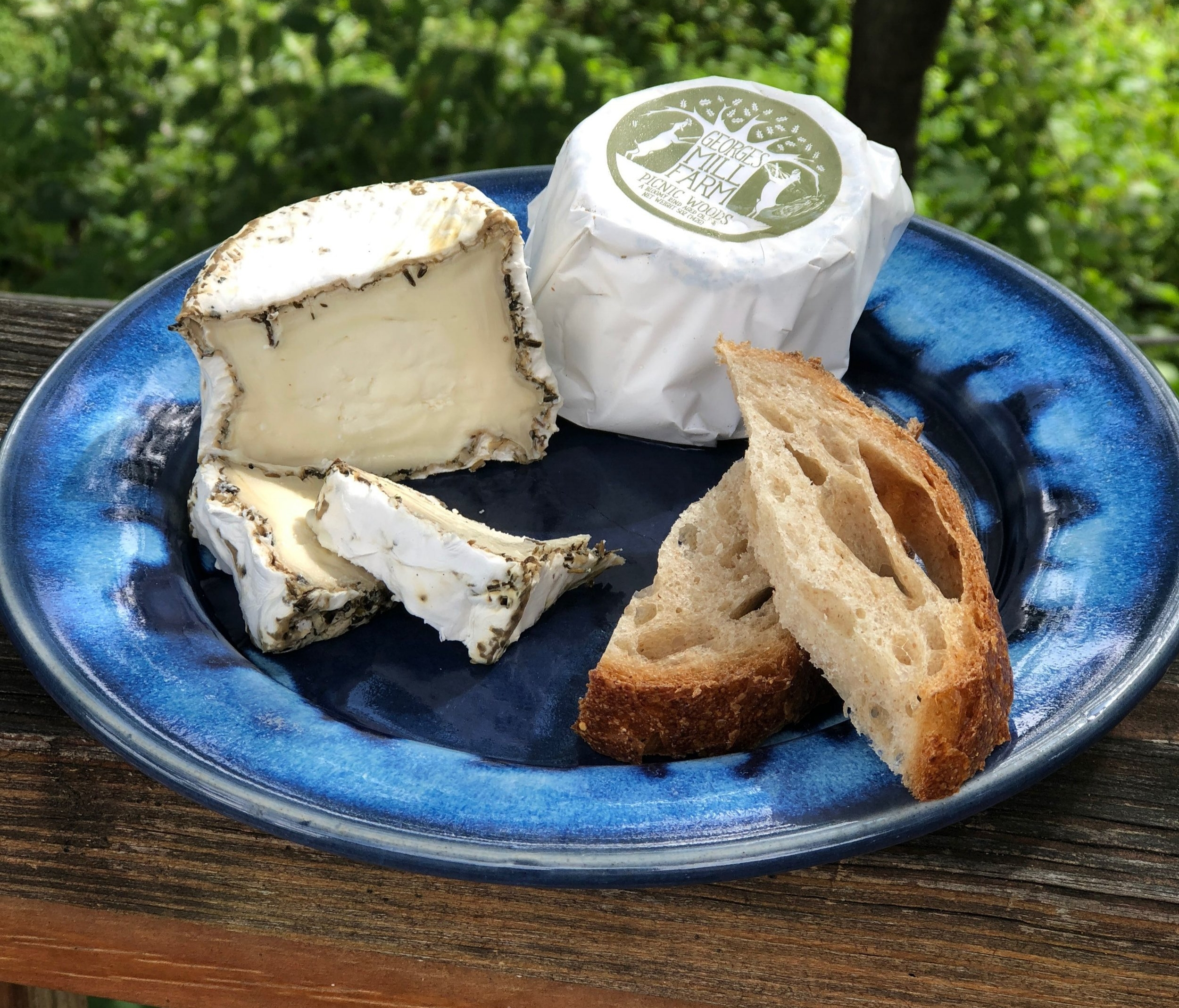 Picnic Woods , our herbed bloomy rind, rolled in herbs de provence and aged 2-8 weeks during which it changes from firm and herbacious to soft and earthy.