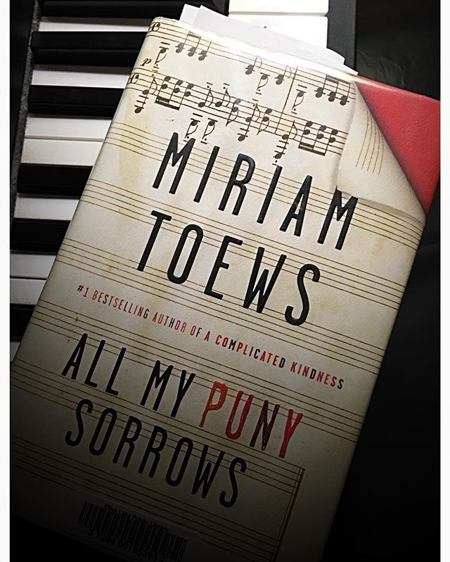 #reading this weekend, against the sturm und drang of thunderstorms and the threat of candlelight. #rainyday #rainydayreading #amreading #canlit #readers #readersofinstagram #musiciansofinstagram #musicians #miriamtoews #allmypunysorrows #piano
