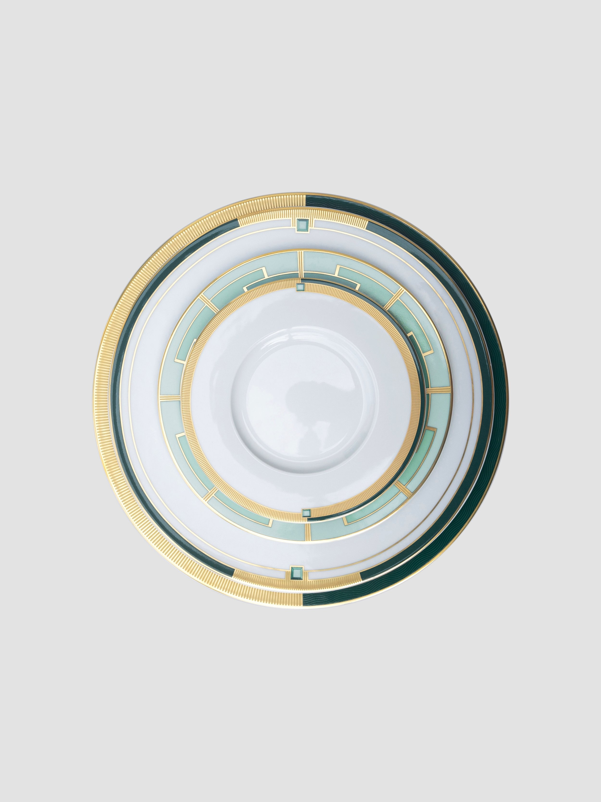 Harmonious emerald tones, a geometric palette and 24kt decal blend beautifully to compose this Art Deco movement.   Artistically crated in Portugal.