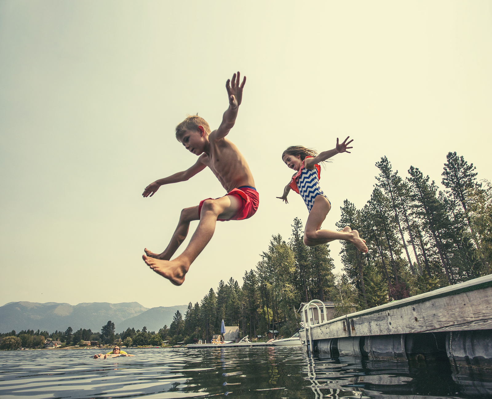 bigstock-Kids-jumping-off-the-dock-into-117925061.jpg
