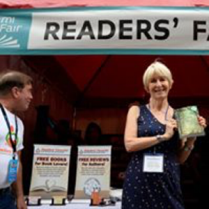 The thrill of being photographed at the Readers' Favorite booth at the Miami Book Fair with my book: