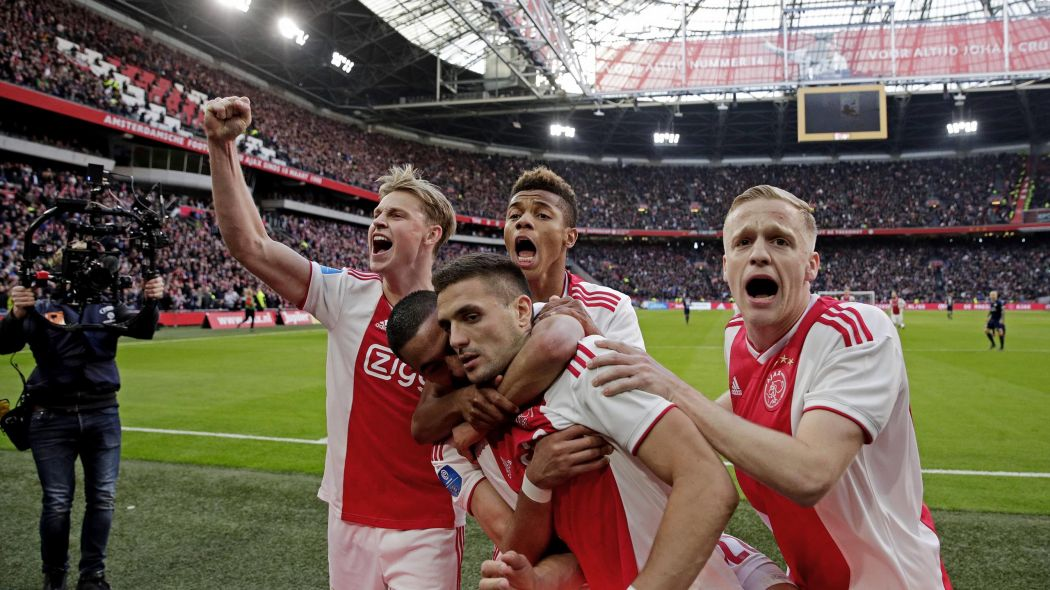 Dusan Tadic (front, centre) is mobbed by his teammates after scoring their second goal in the decisive 3-1 victory over PSV Eindhoven in March.