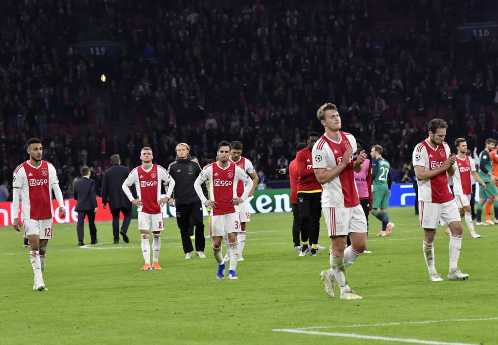 Ajax players trudge disconsolately off the pitch after their Champions League semi-final heartbreak against Tottenham Hotspur