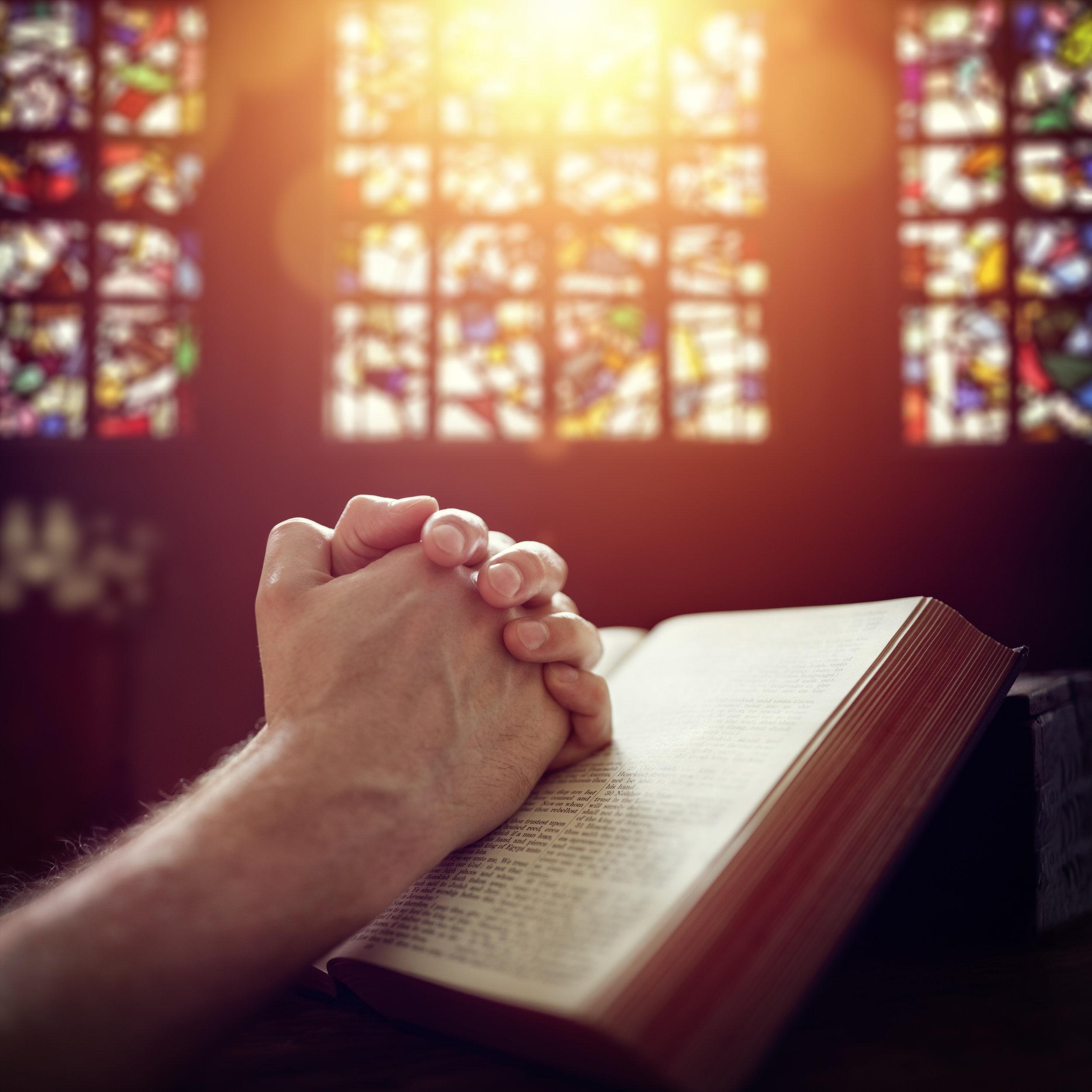 Praying-hands-on-a-Holy-Bible-505067134_3159x3159.jpeg