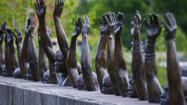 "This photo shows a bronze statue called ""Raise Up"", part of the display at the National Memorial for Peace and Justice, a new memorial to honor thousands of people killed in lynchings, April 23, 2018, in Montgomery, Ala. (AP Photo/Brynn Anderson)"
