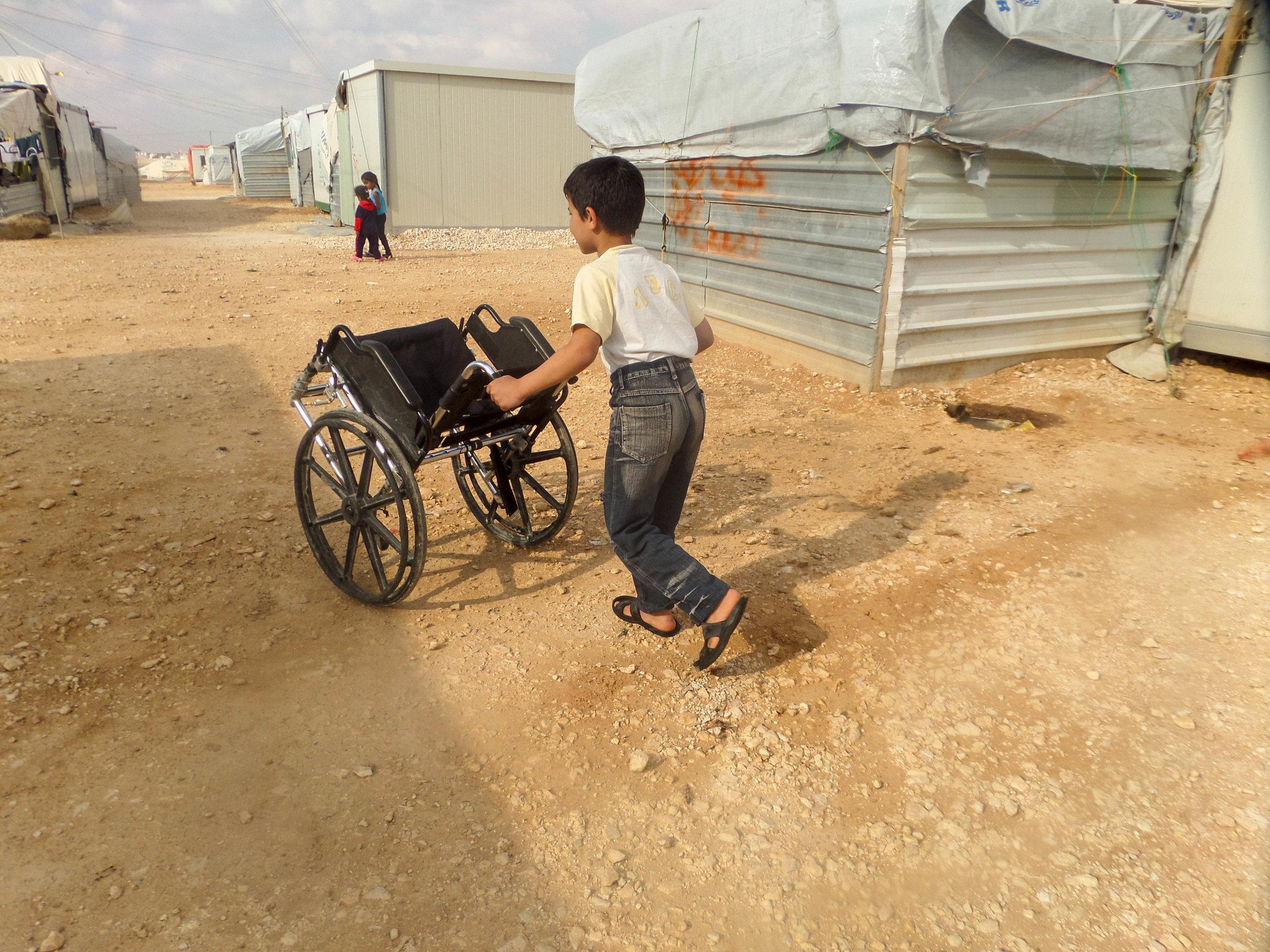 _6sharook.wheelchairboy.jpg