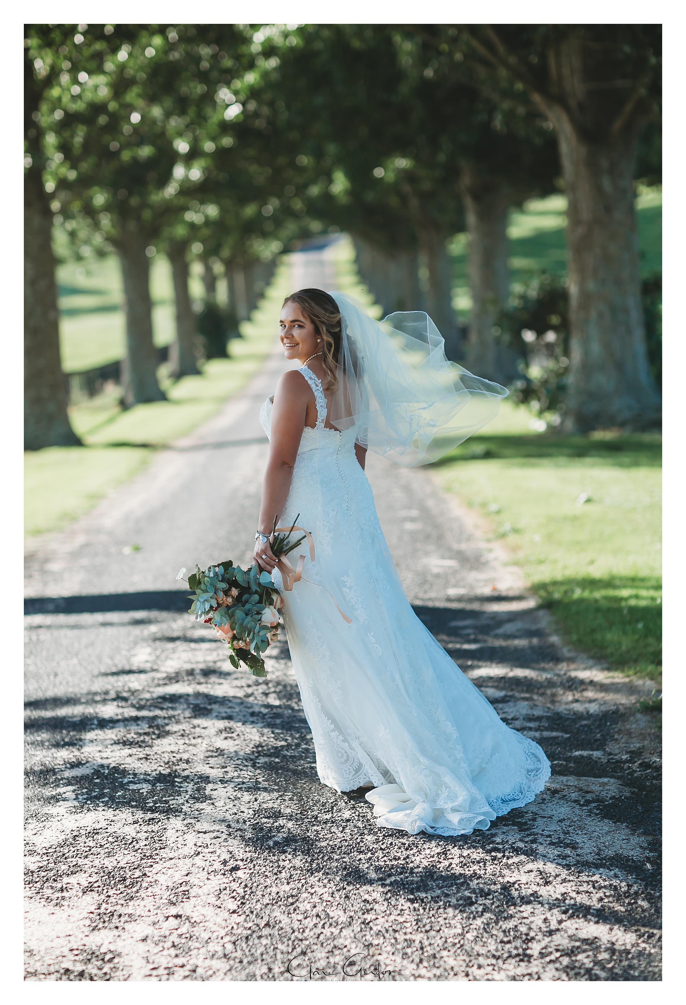 red-barn-wedding-bride-on-driveway-tirau-waikato-wedding (85).jpg