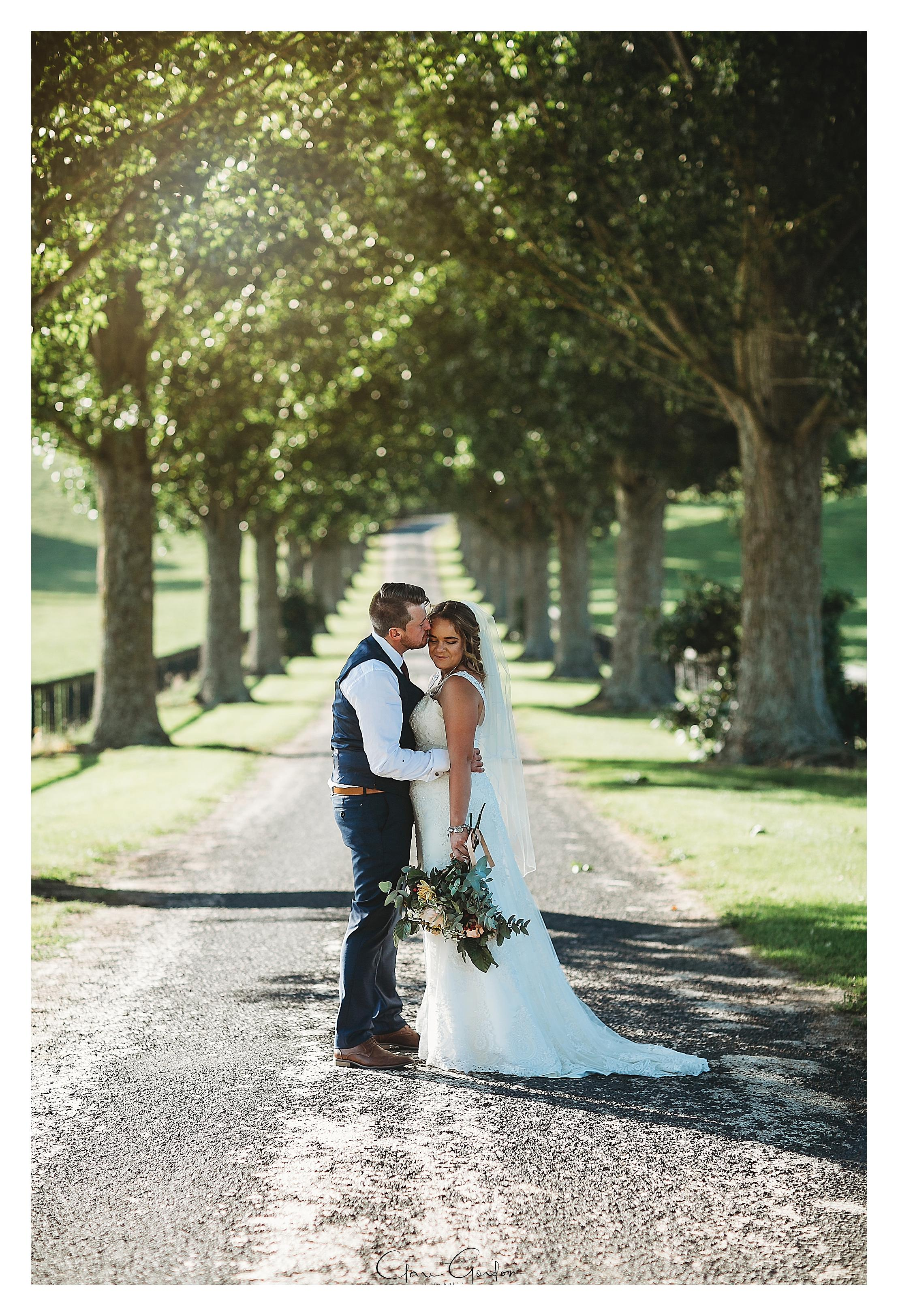 red-barn-wedding-brie-and-groom-on-driveway-tirau-waikato-wedding (86).jpg