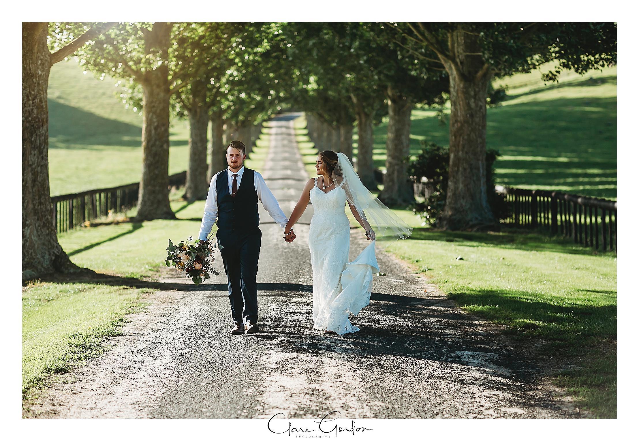 red-barn-wedding-bride-and-groom-on-driveway-tirau-waikato-wedding (87).jpg