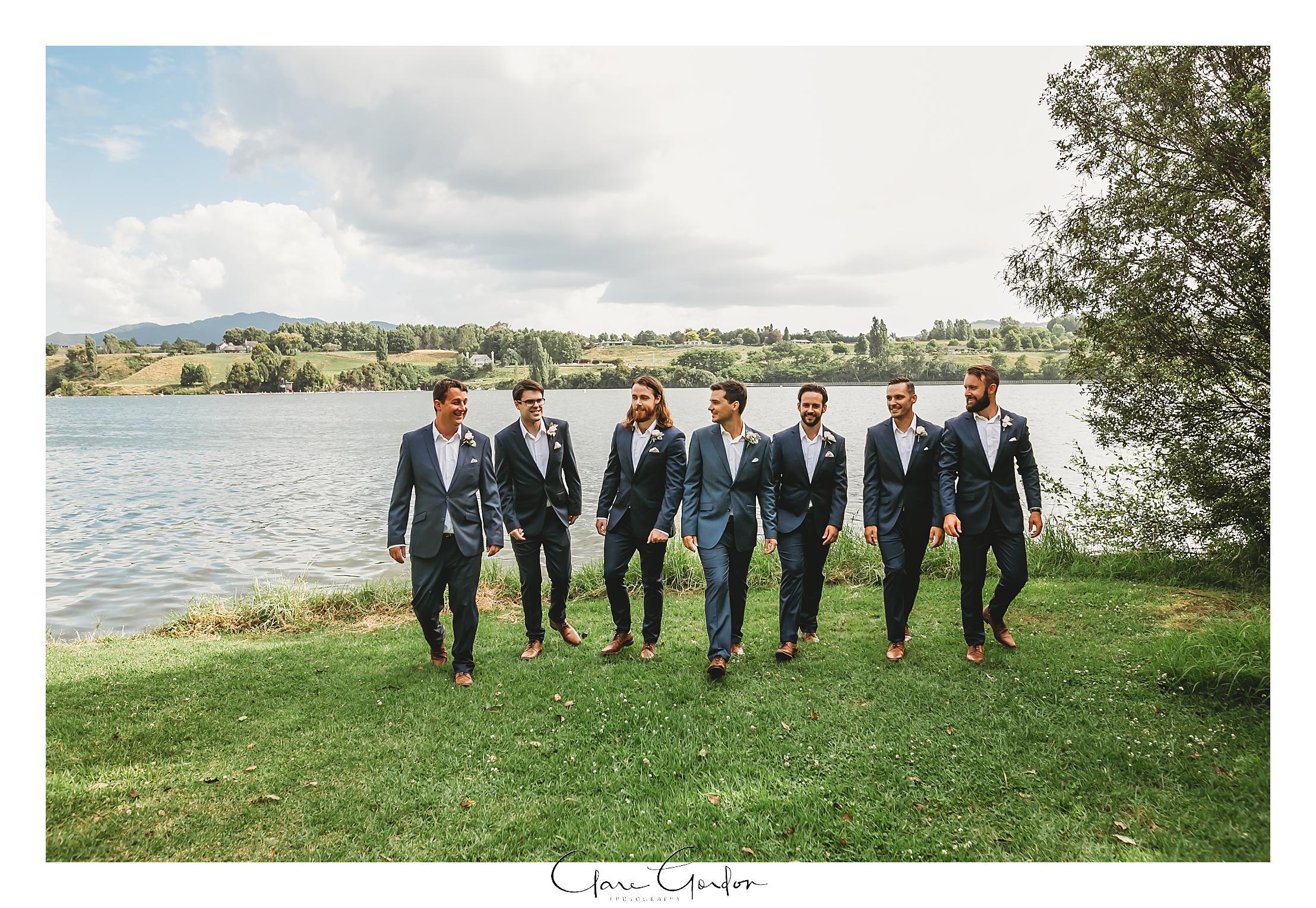 groomsmen-walking-the-boat-shed-lake-karapiro
