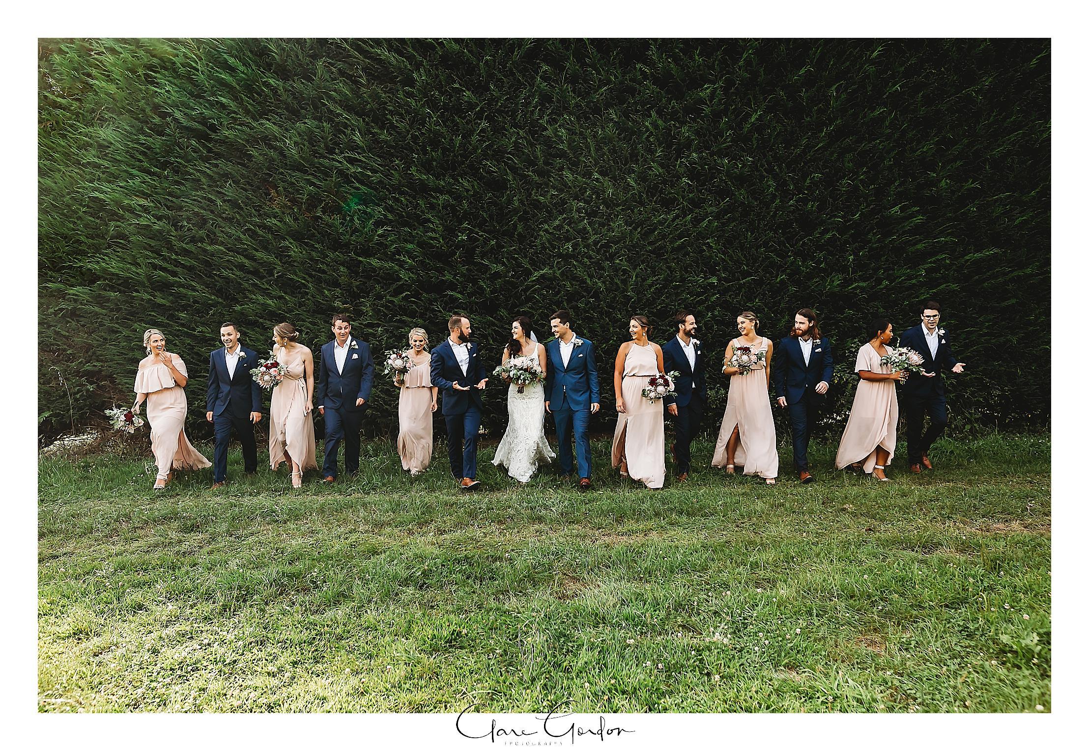 bridal-party-walking-photo-the-boat-shed-lake-karapiro