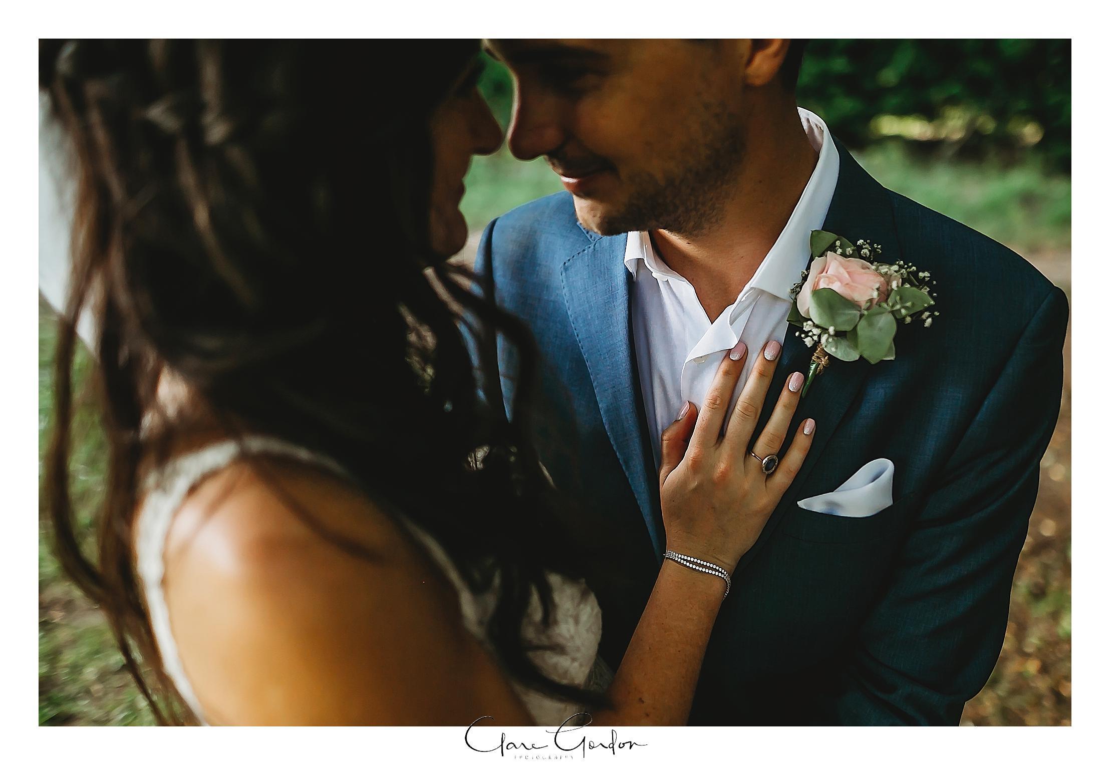 bride-and groom-hugging-romantic-photo-the-boat-shed-lake-karapiro