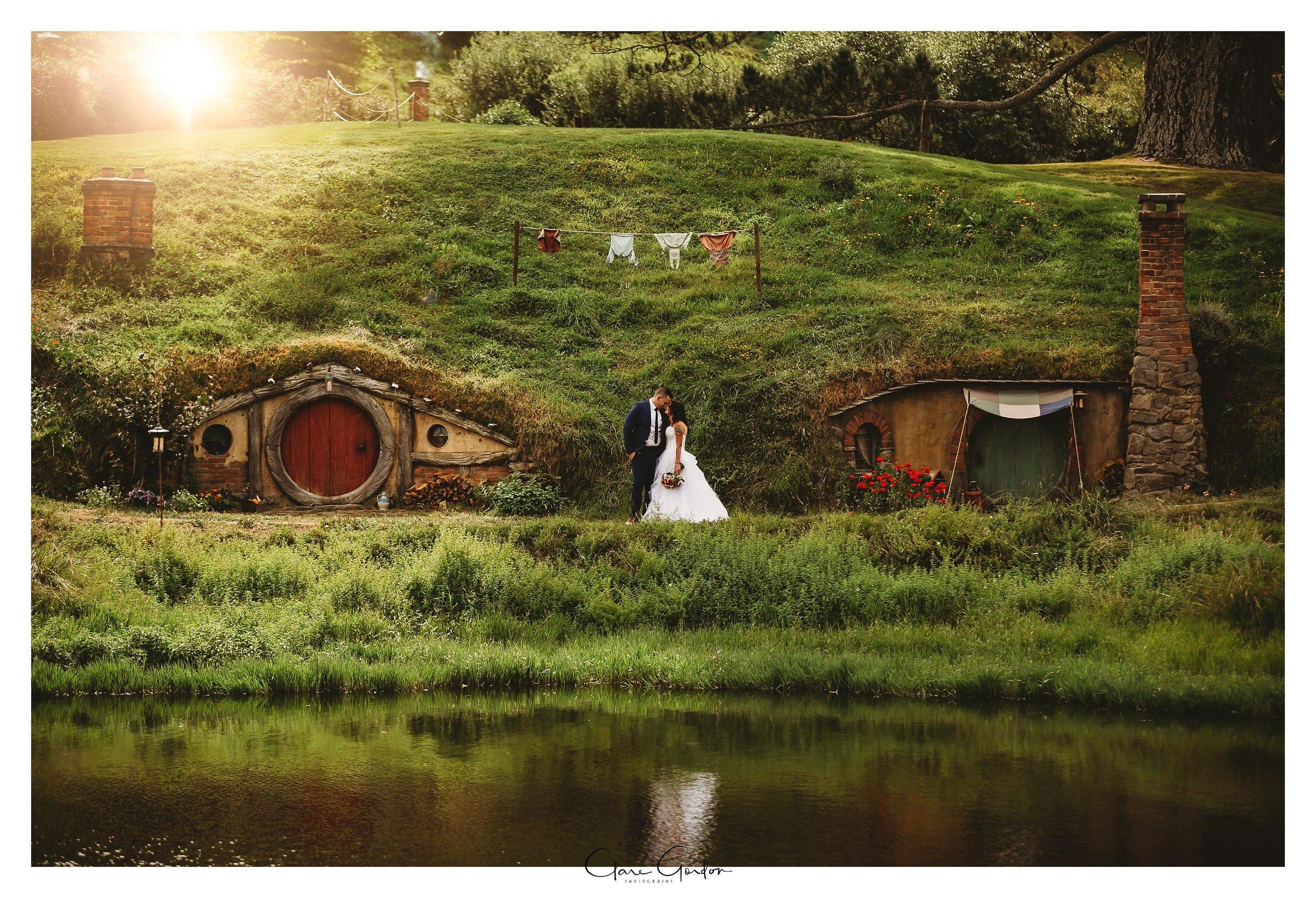 Hobbtion-wedding-photo-bride-and-groom-by-lake
