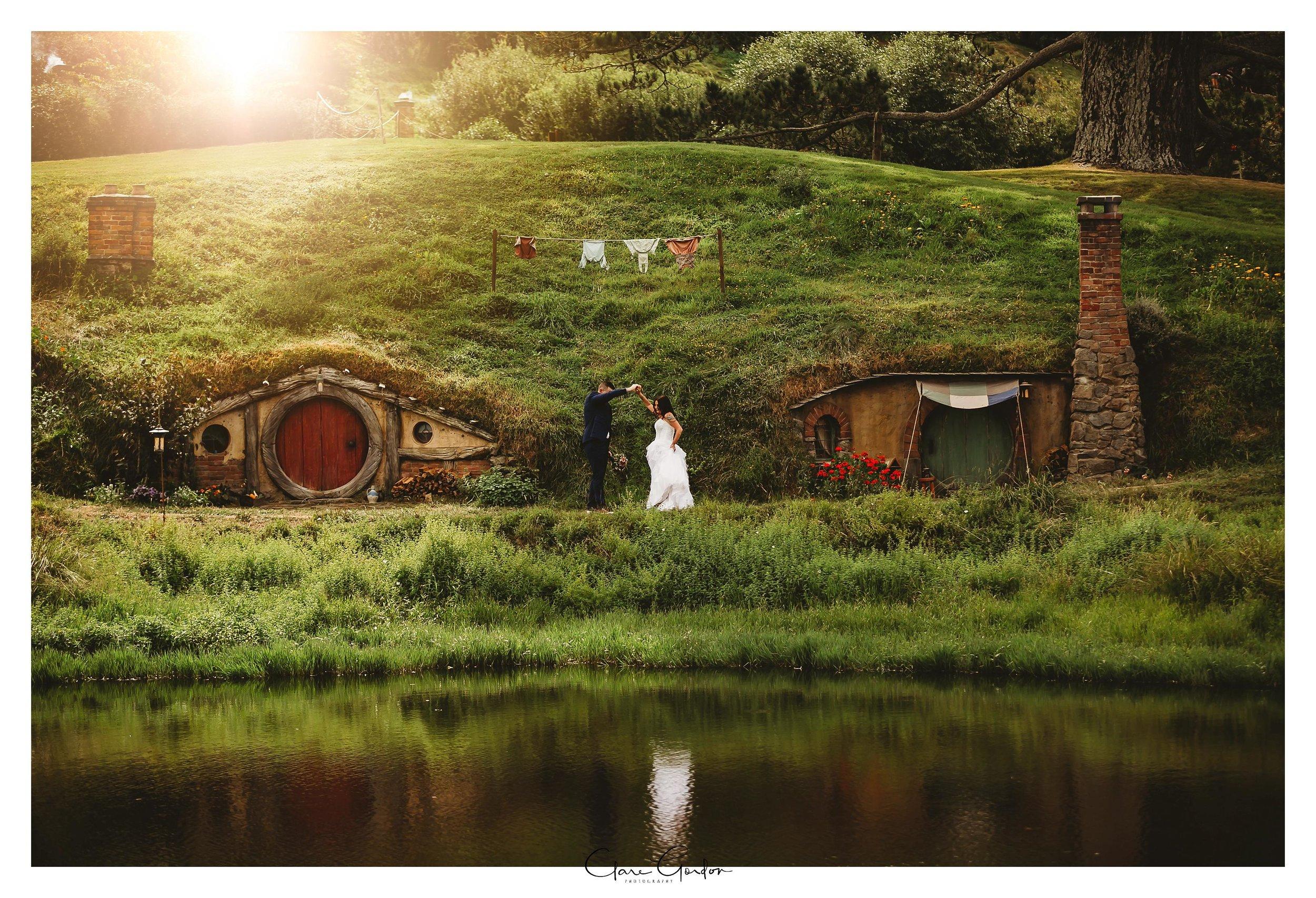 Hobbiton-wedding-photo-Bride-and-groom-Walking-dancing-by-lake (3).jpg