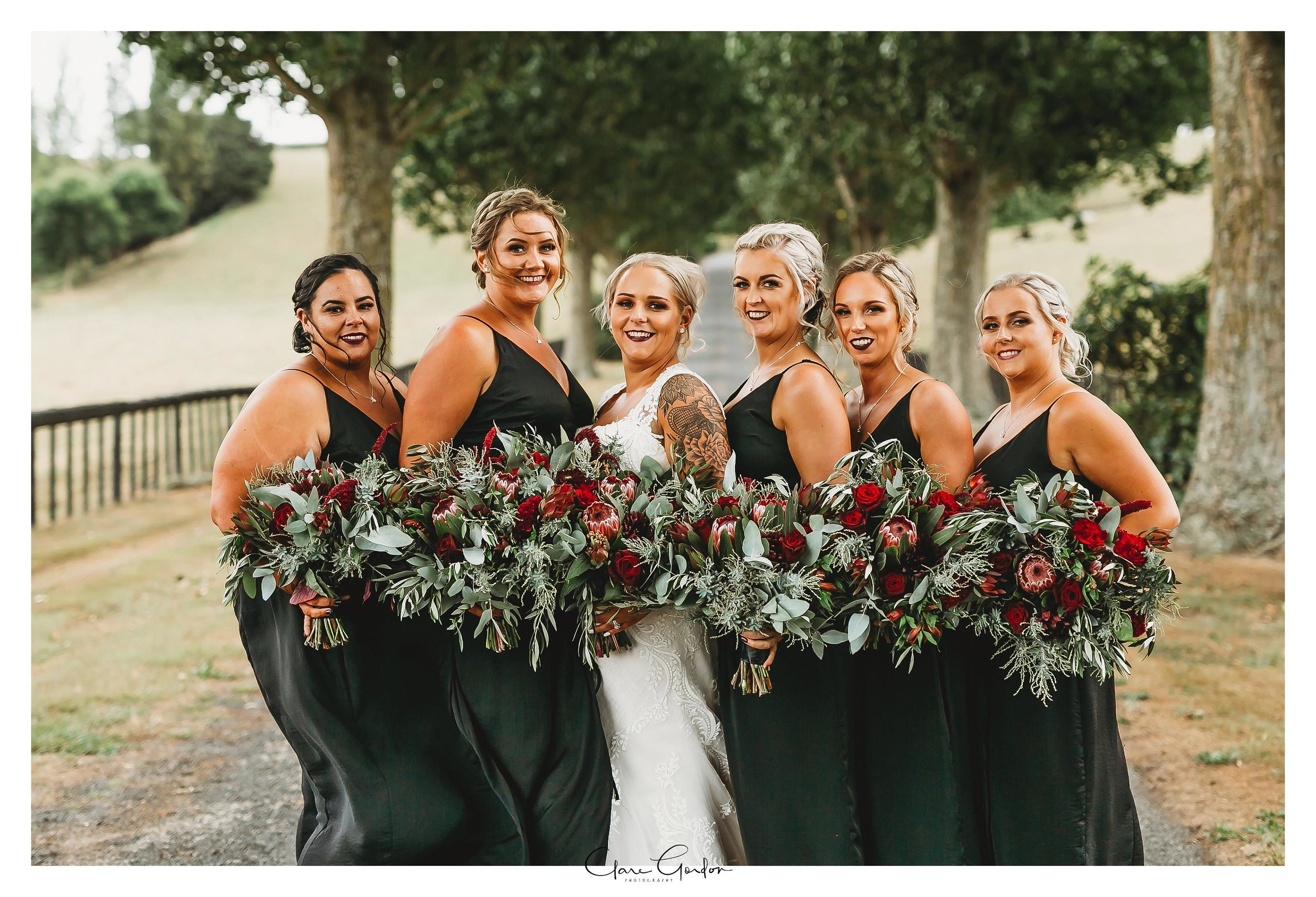 The-red-barn-wedding-Waikato-NZ_bridesmaids-on-driveway (63).jpg