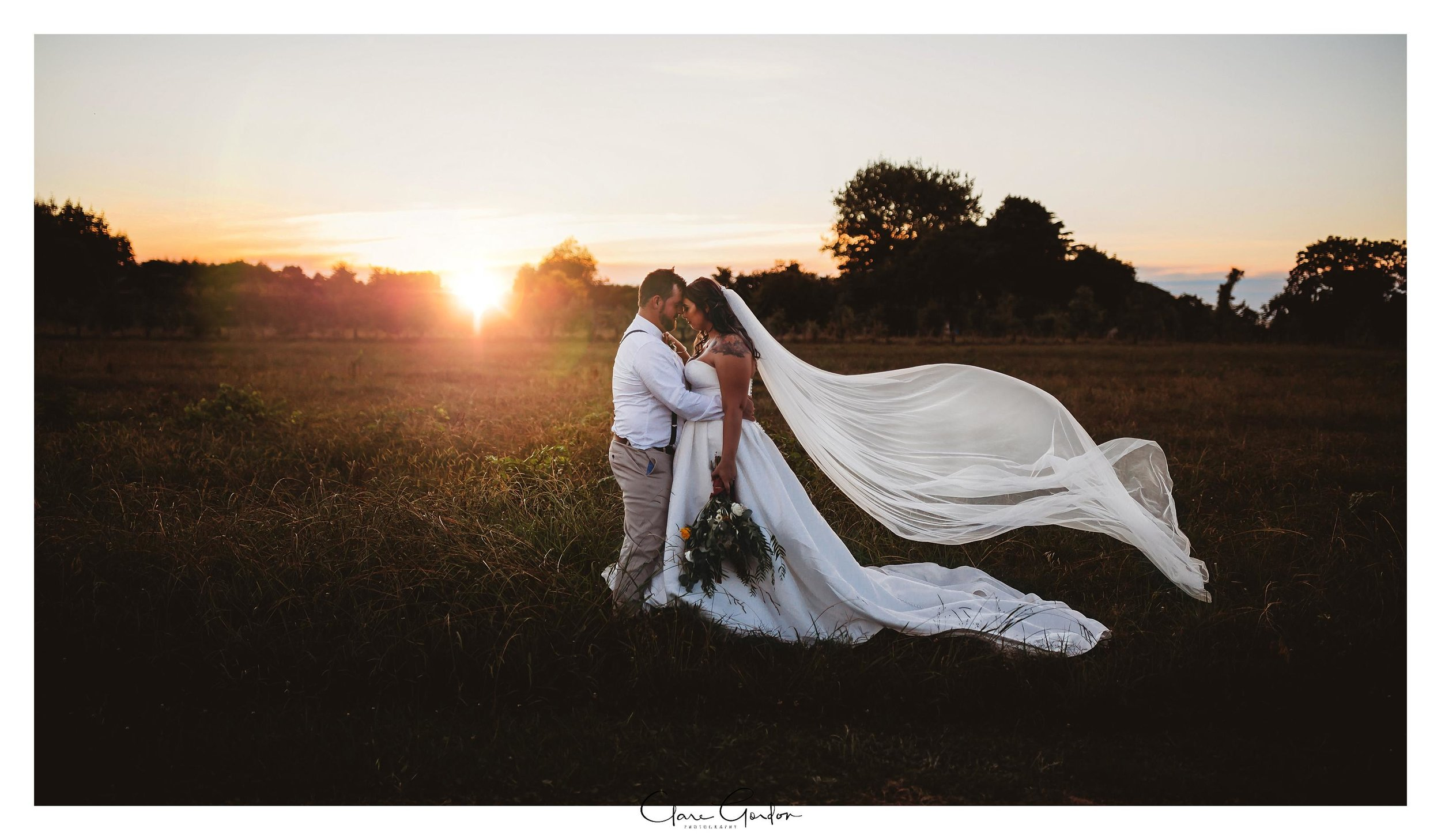 Bride-and-groom-at-sunset-coopers-function-rooms-waikato-clare-gordon-photography
