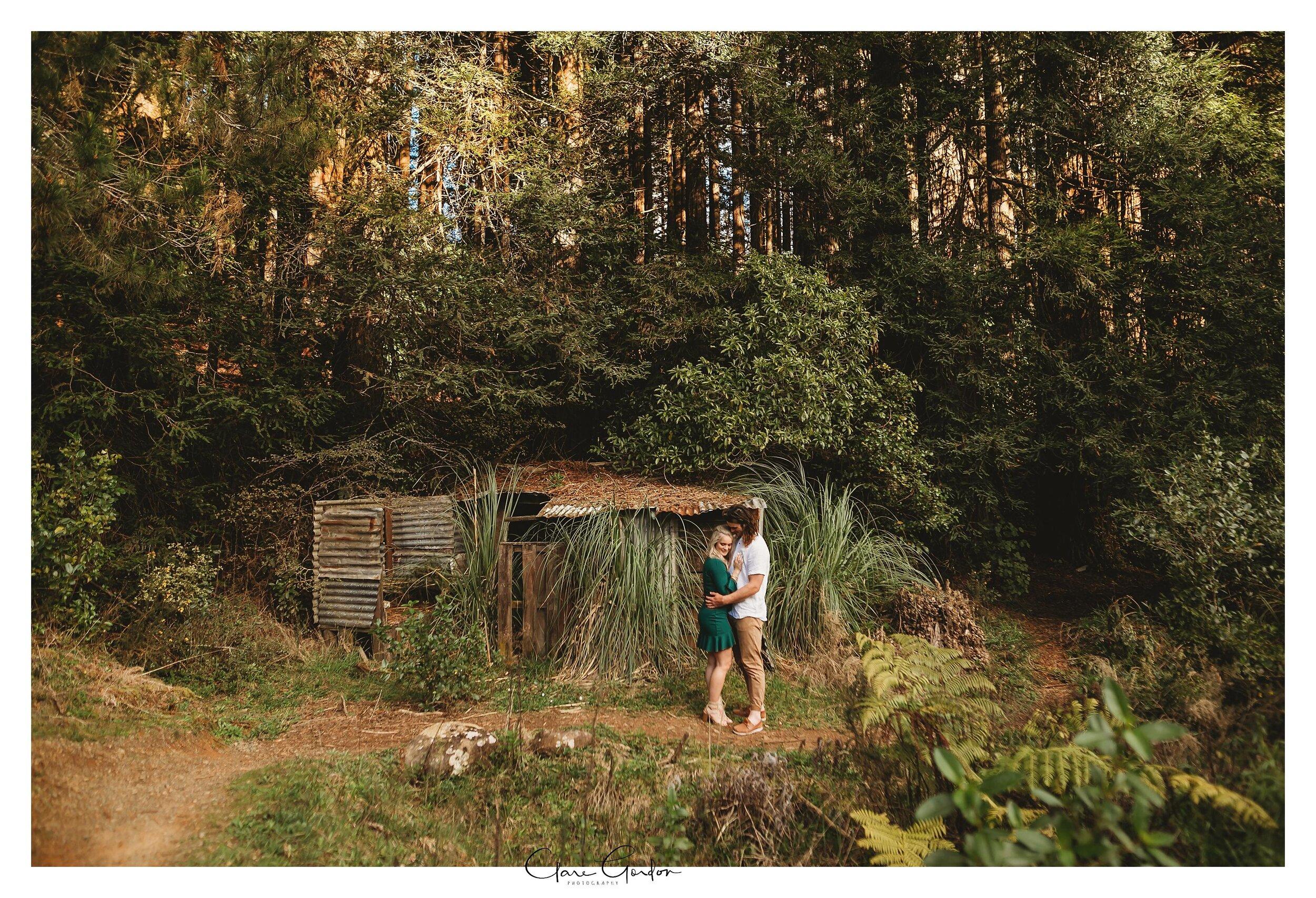 Waikato-engagement-photo-TeMiro-couple-hugging-in-forest-Newzealand-wedding-photographer (7).jpg