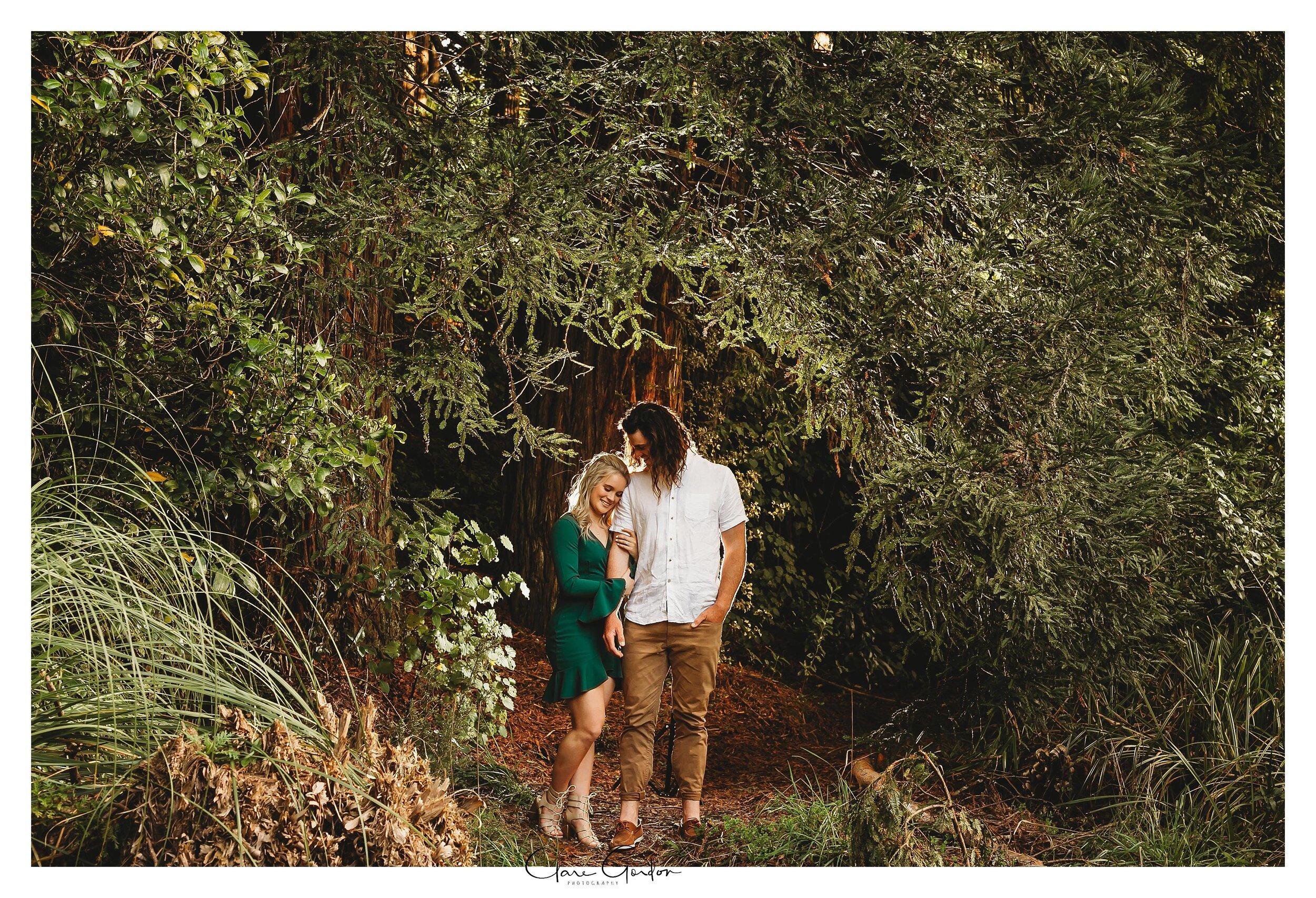 Waikato-engagement-photo-TeMiro-couple-hugging-in-forest-Newzealand-wedding-photographer (8).jpg