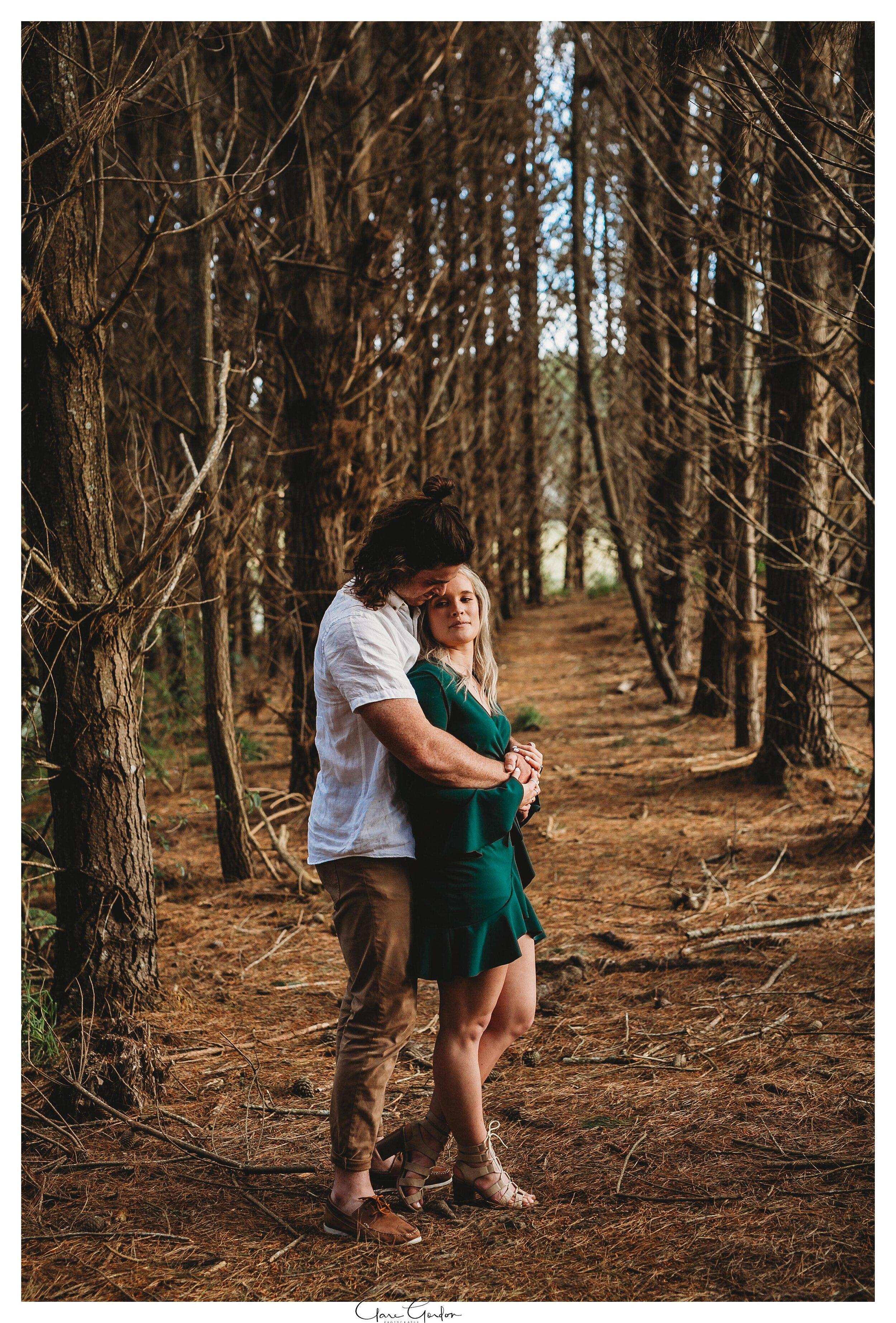 Waikato-engagement-photo-TeMiro-couple-hugging-in-forest-Newzealand-wedding-photographer (11).jpg