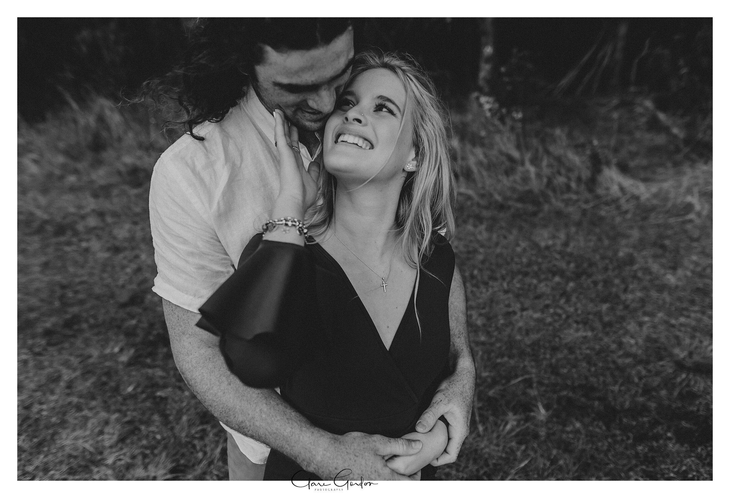Waikato-engagement-photo-TeMiro-couple-hugging-in-forest-Newzealand-wedding-photographer (23).jpg