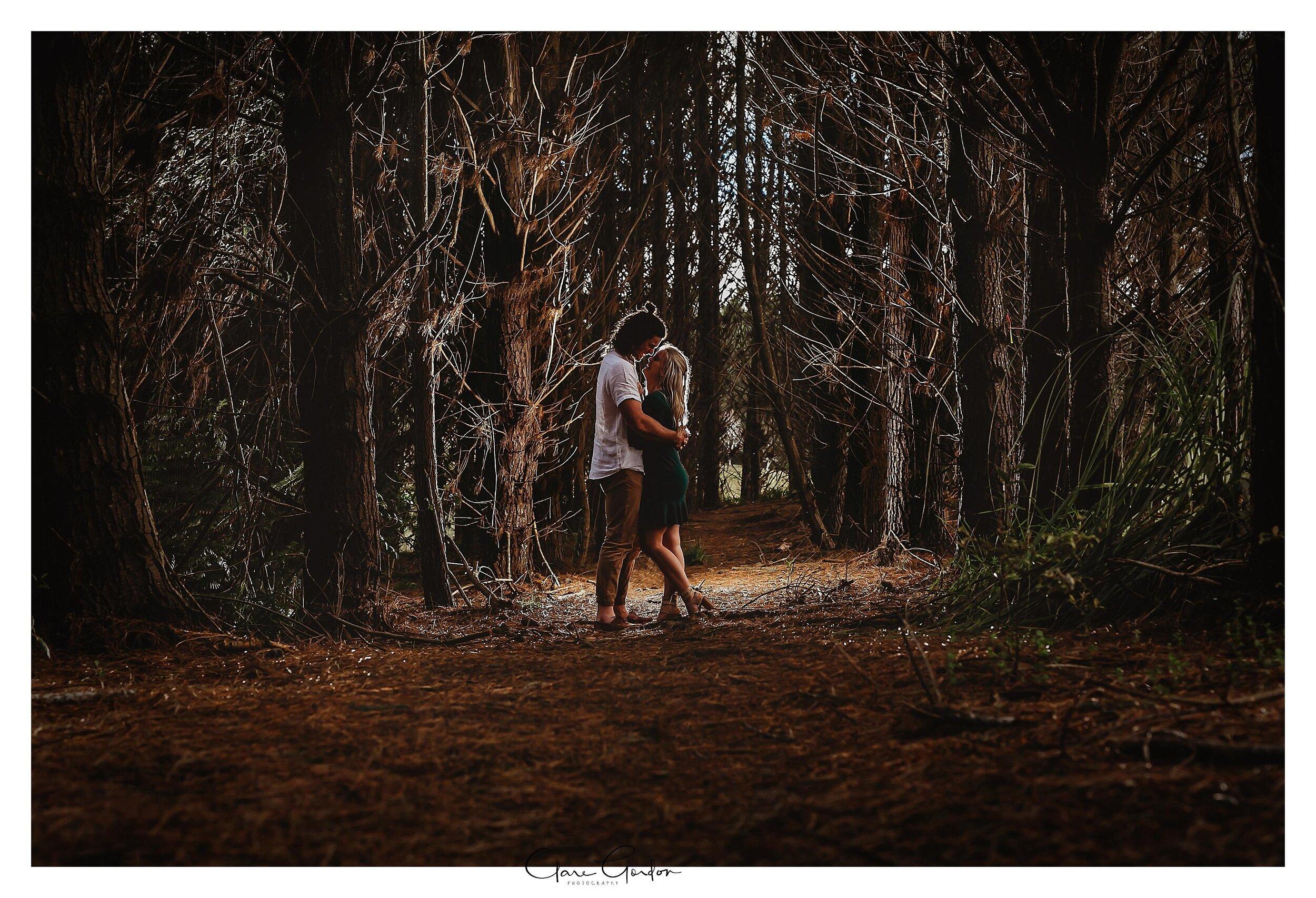 Waikato-engagement-photo-TeMiro-couple-hugging-in-forest-Newzealand-wedding-photographer (1).jpg